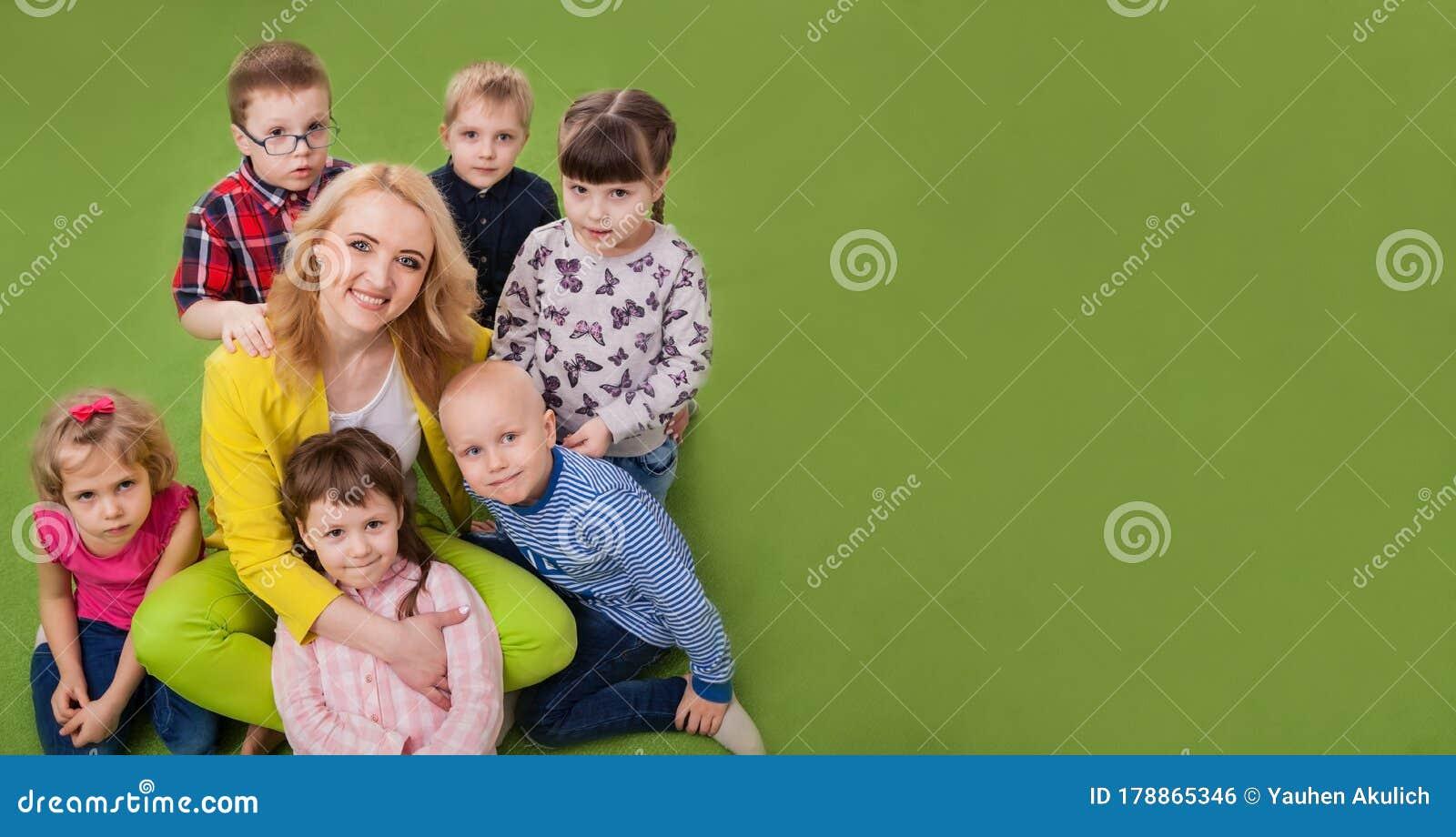 Group Of Kids Boys And Girls Hug Teacher. Children ...