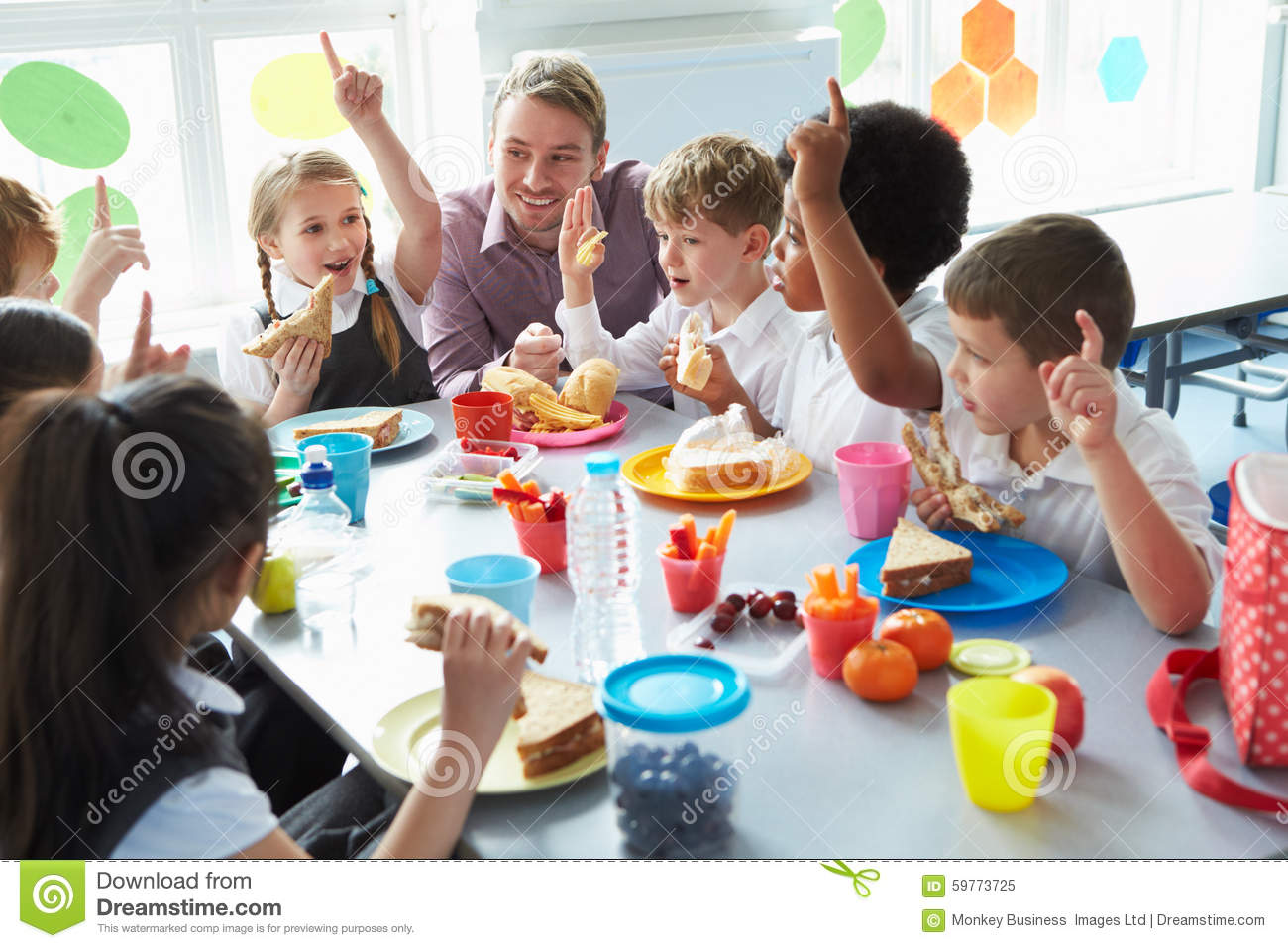 Group of children eating lunch in school cafeteria stock for Group lunch