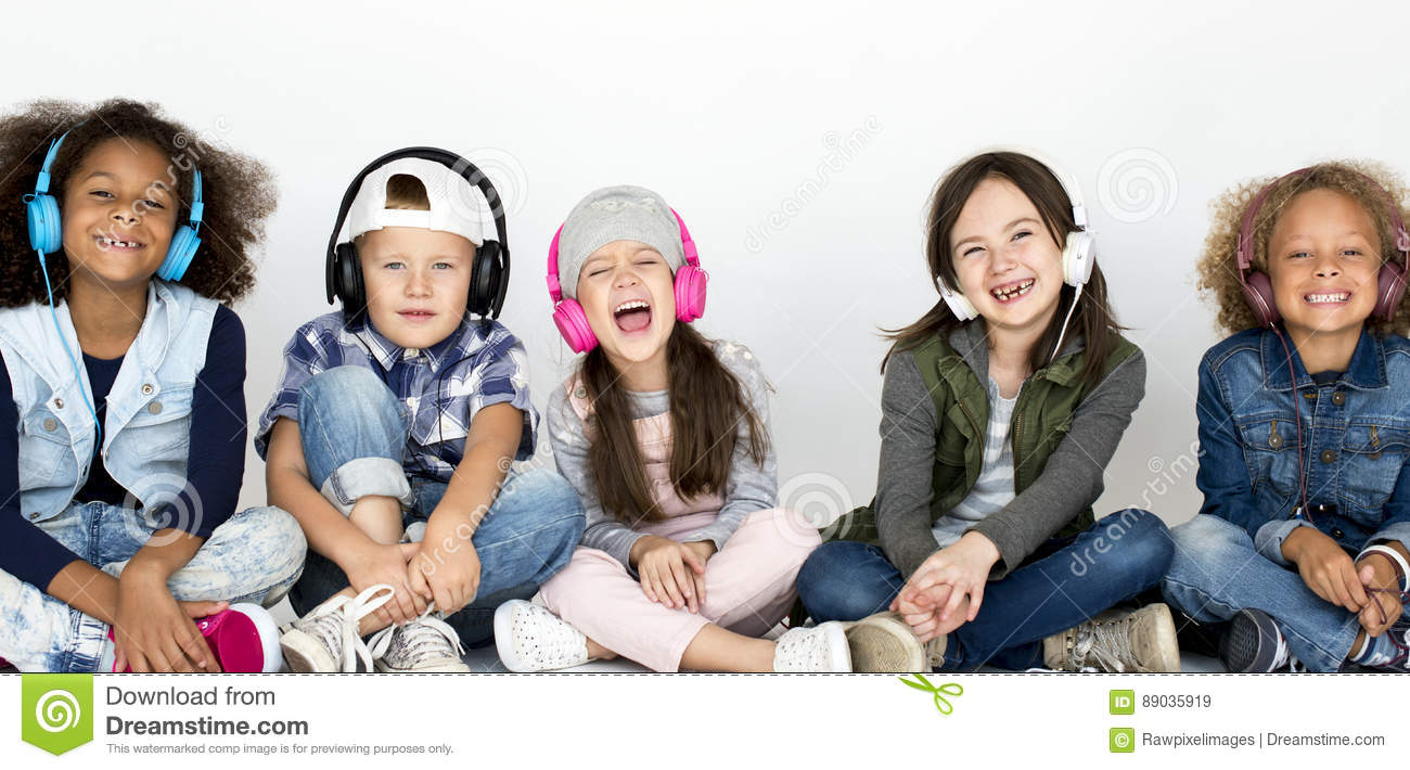 Group of children enjoy the music by headphones