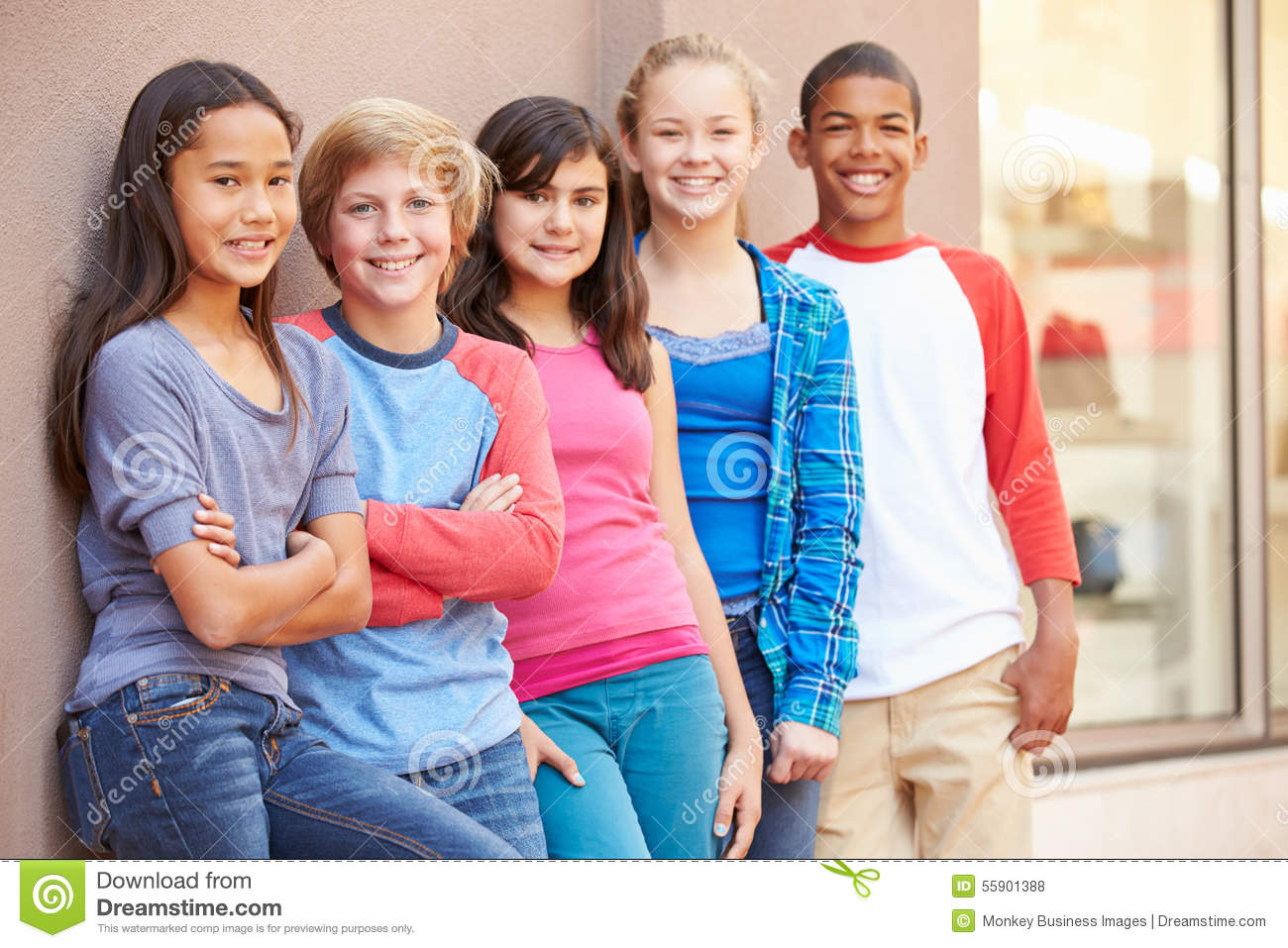 Group of children hanging out together in mall stock photo for Hanging groups of pictures