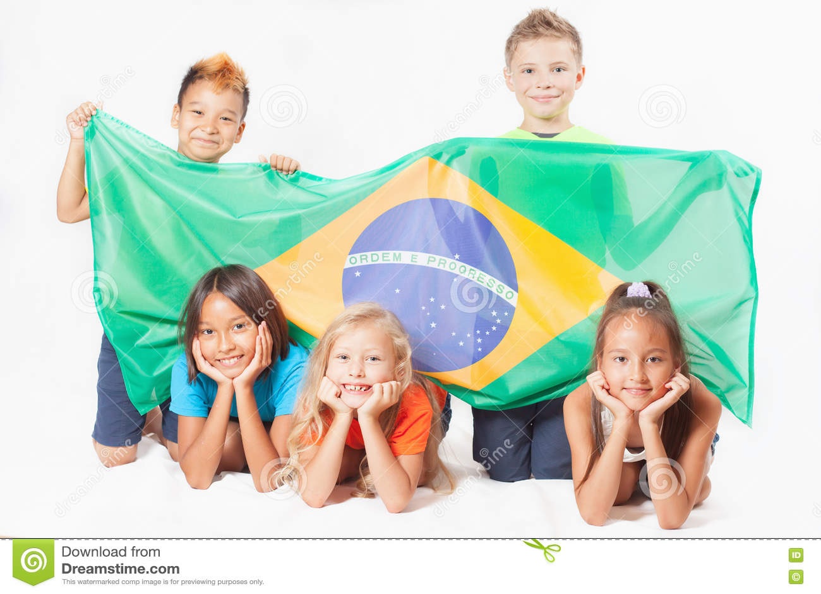 group of children holding a brazil flag stock photo