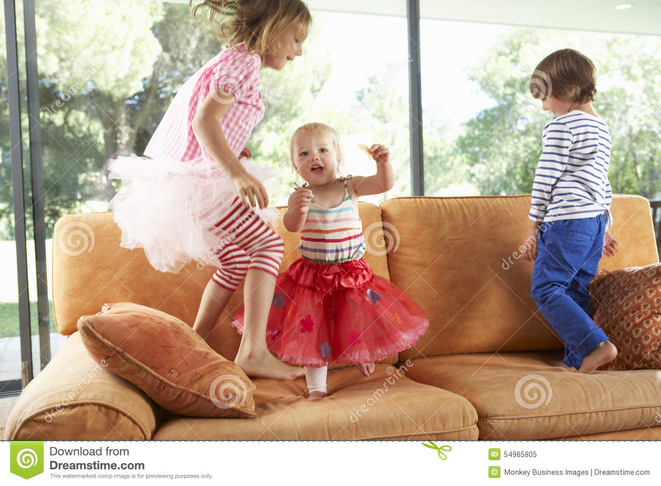 Group Of Children Jumping On Sofa Stock Photo Image