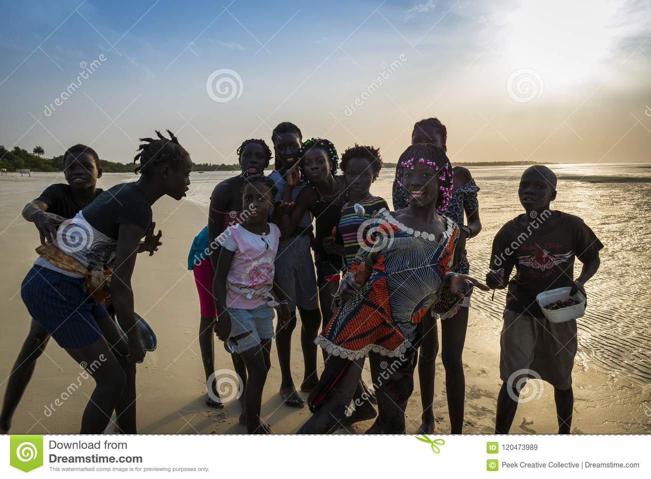 Group of children playing by the beach in the island of Orango at sunset, in Guinea Bissau