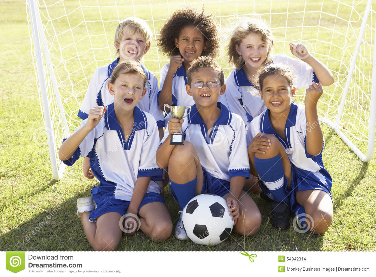 Group Of Children In Soccer Team Celebrating With Trophy ...