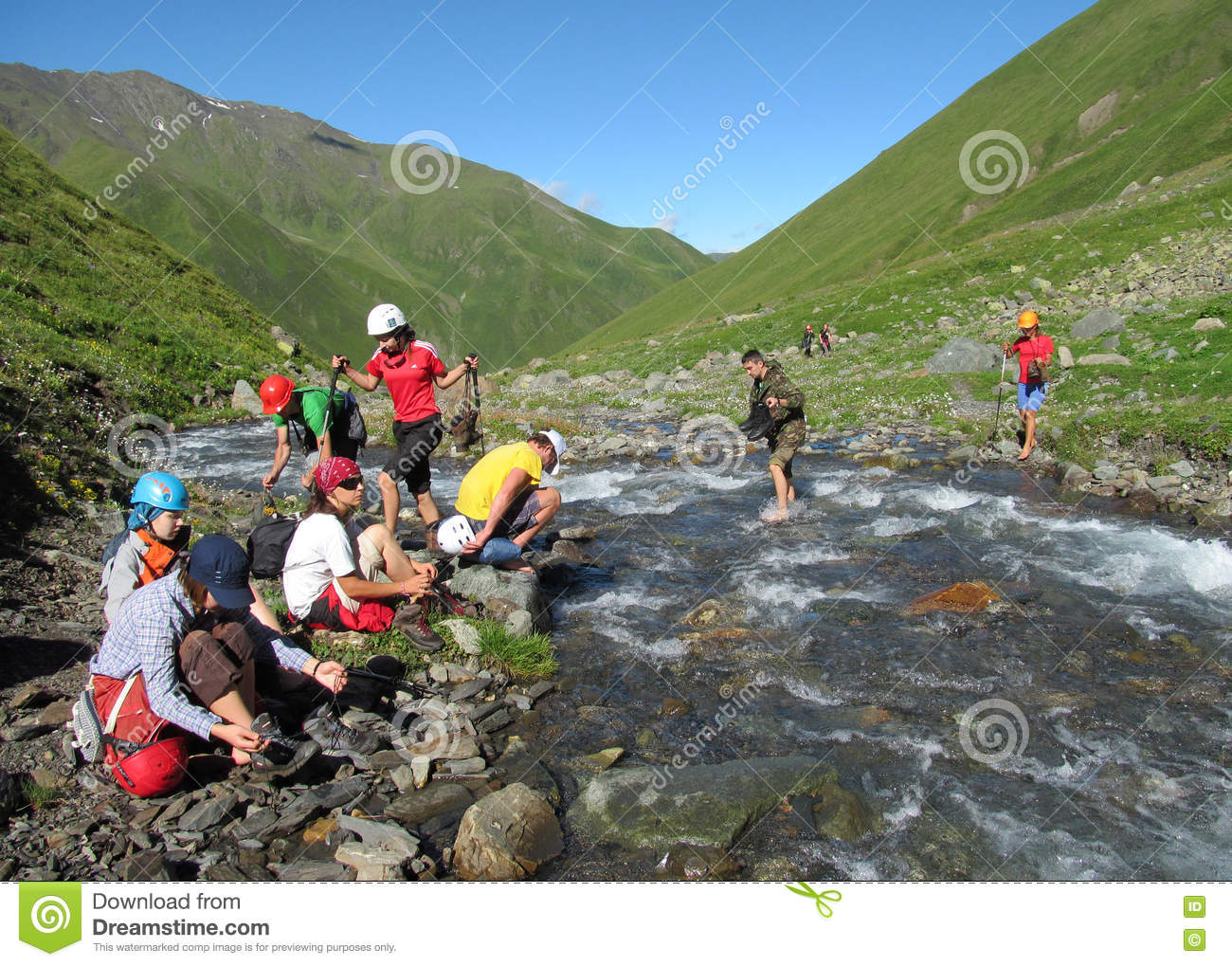 Group of climbers crossing river