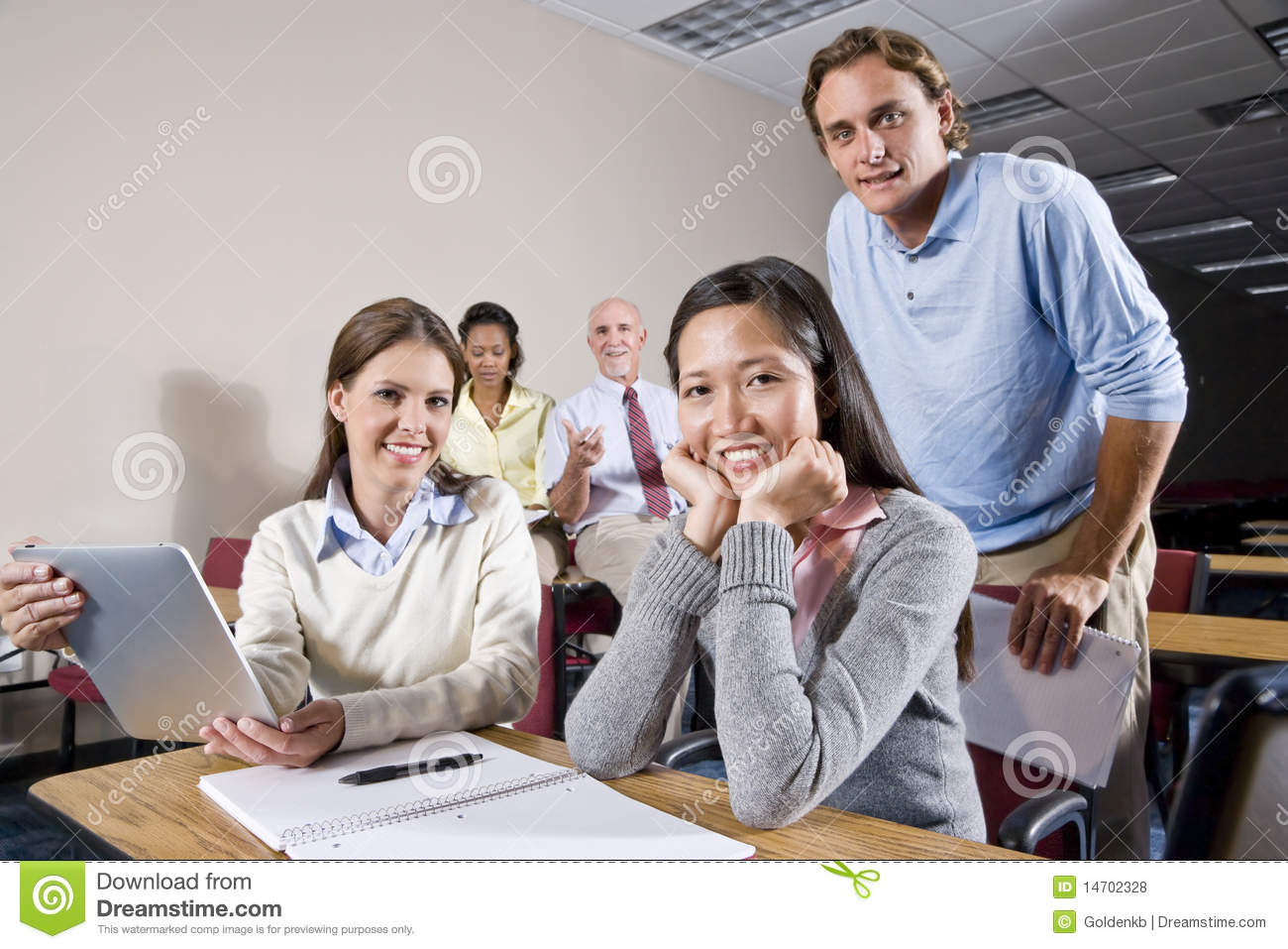 Group of college students and teacher in class