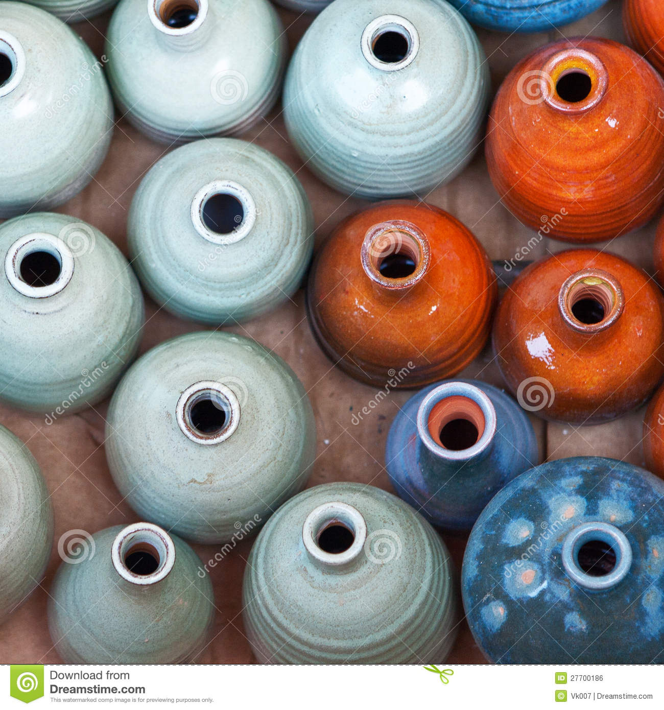 Group of colorful ceramic pots.