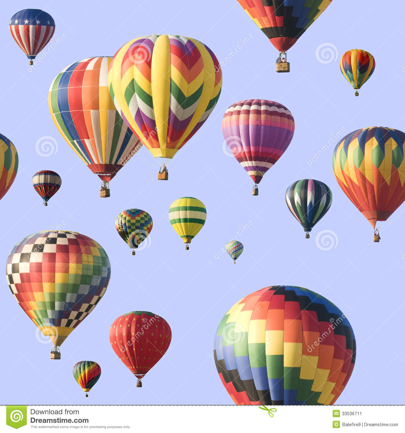 group of colorful hot-air balloons floating across a blue sky. Image ...