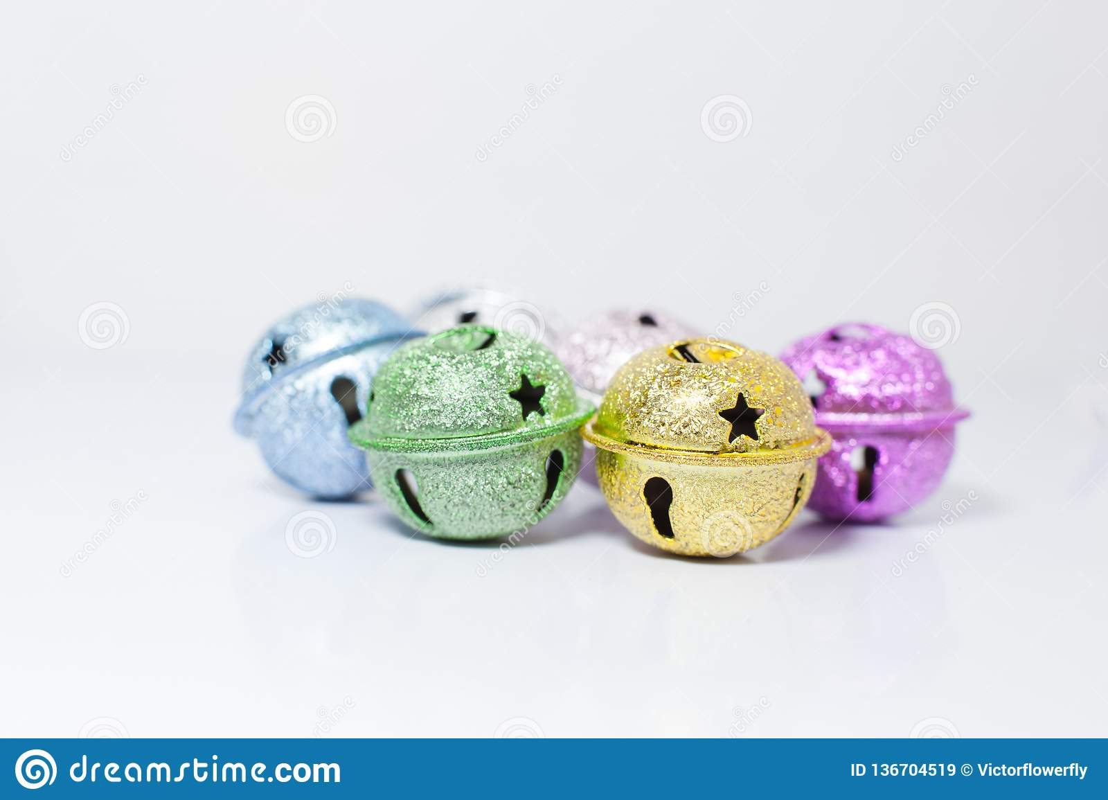 Group of Colorful painted pet small bells for cats and dogs on white background. Pet Shopping Product, Accessories, Animal Tracing