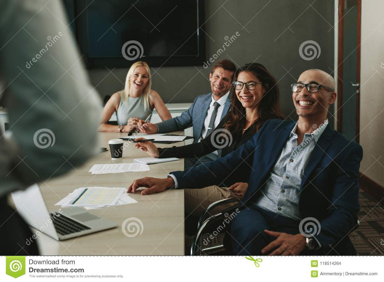Business people smiling during meeting in board room