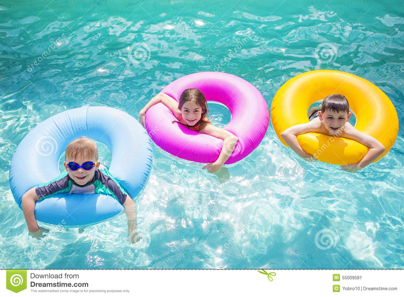 Group of cute kids playing on inflatable tubes in a for Cute pool pictures