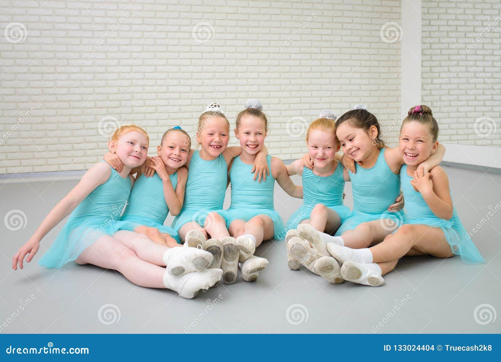 Group of cute little ballet dancers having fun at dance school class.