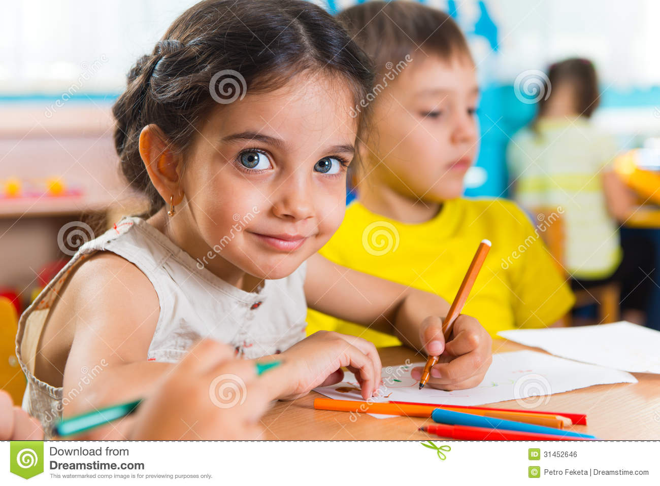 Group of cute little prescool kids drawing