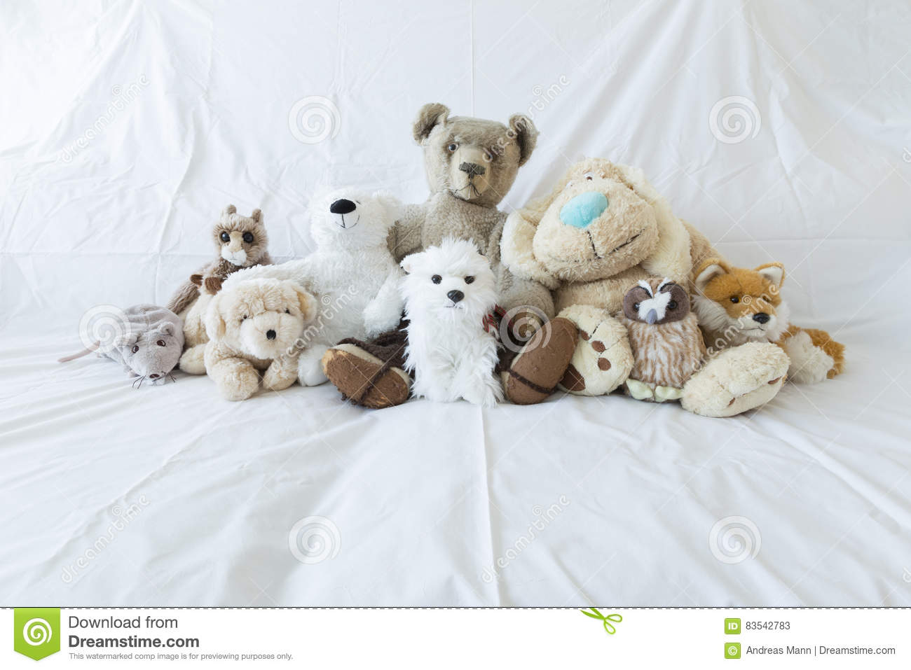 Group of cute stuffed animals on a white couch