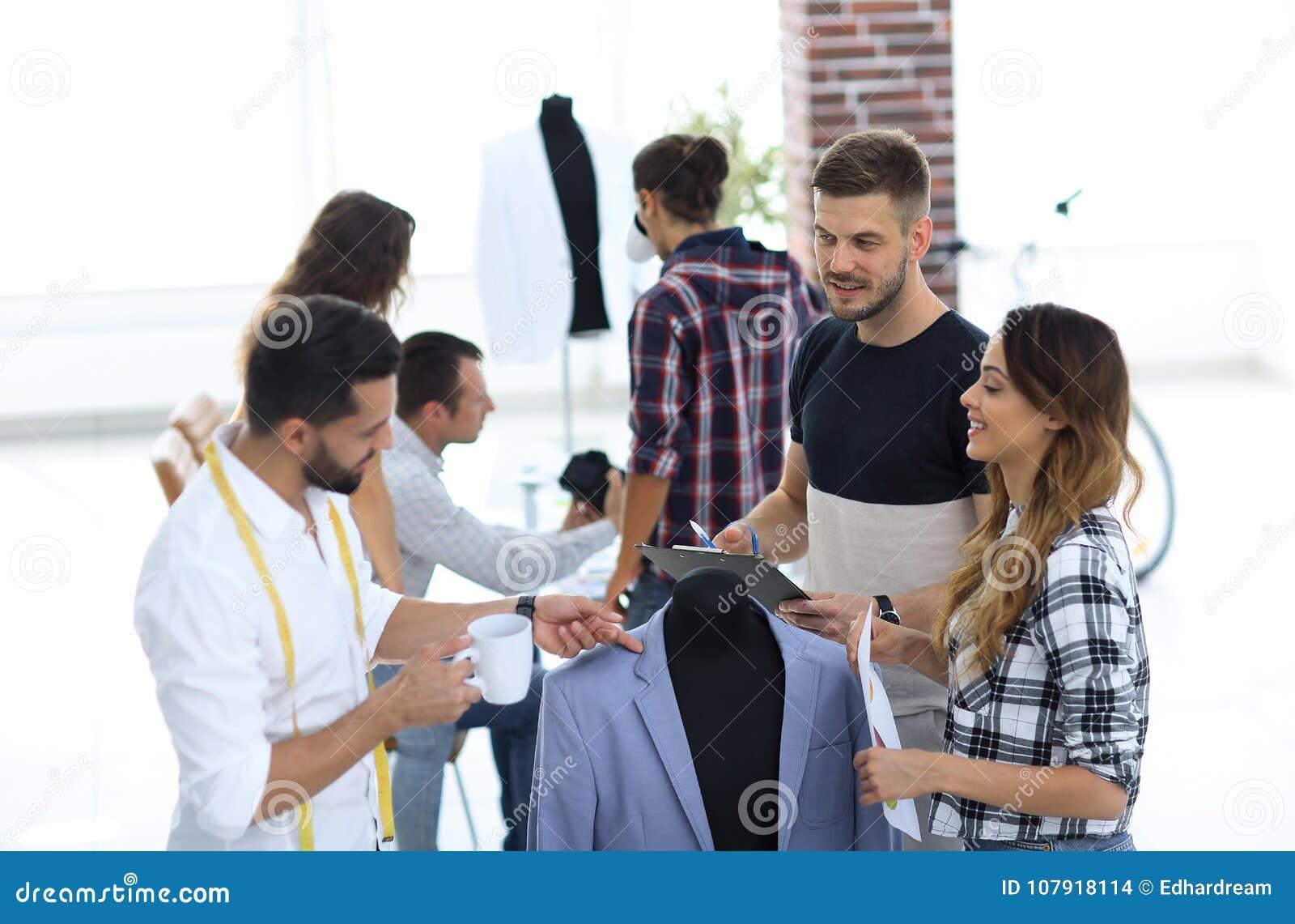 Group Of Designers Discuss Men`s Suit Stock Photo - Image ...