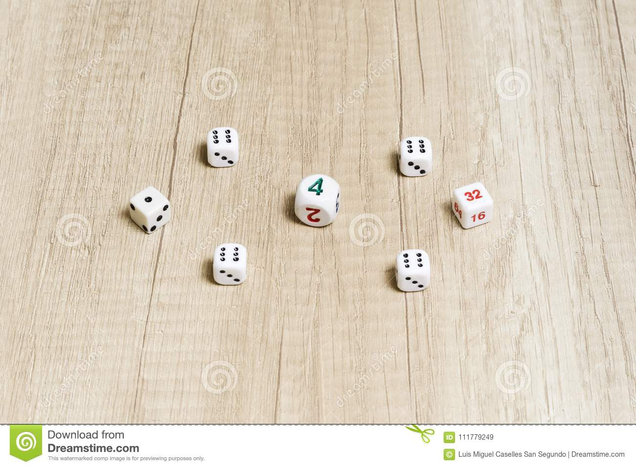 Game of dice on a wooden table