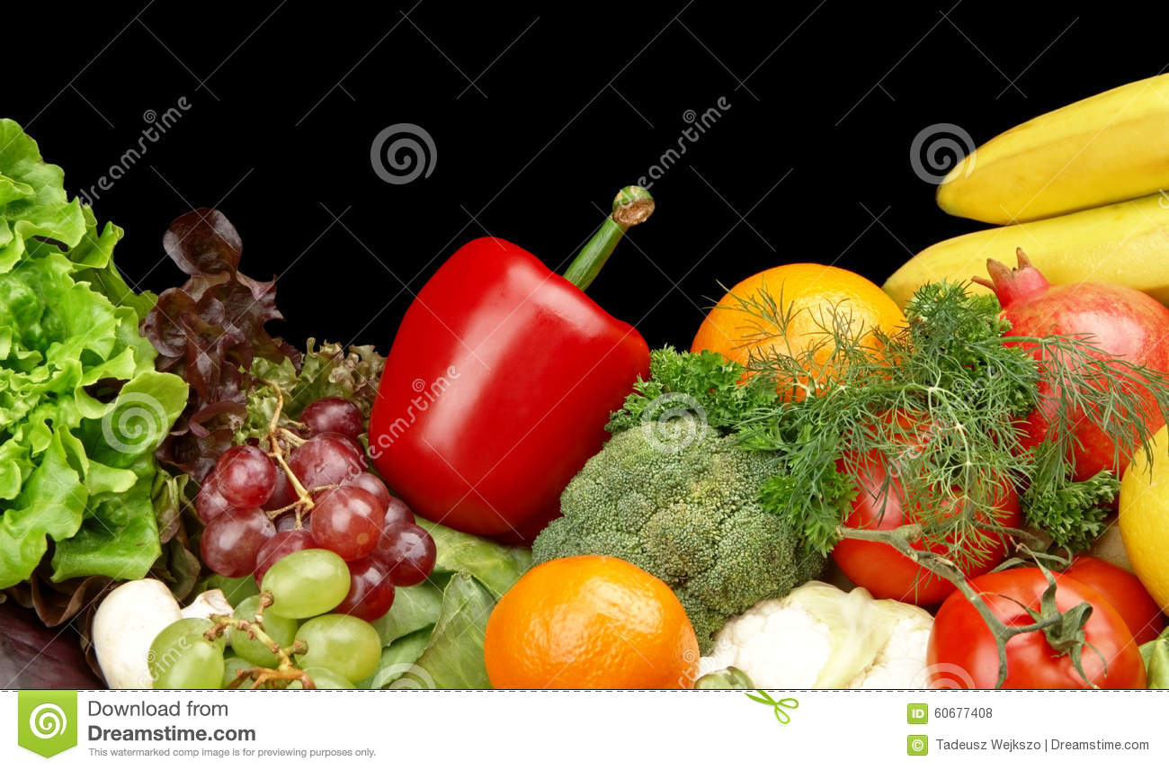 Group of different vegetables and fruits on black