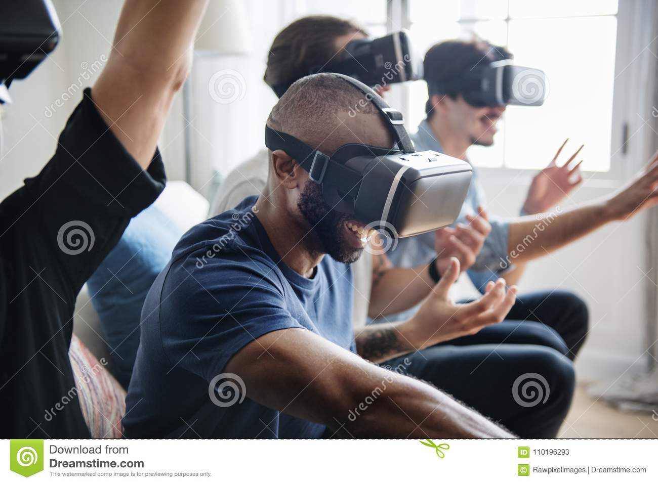 Group of diverse friends experiencing virtual reality with VR hea