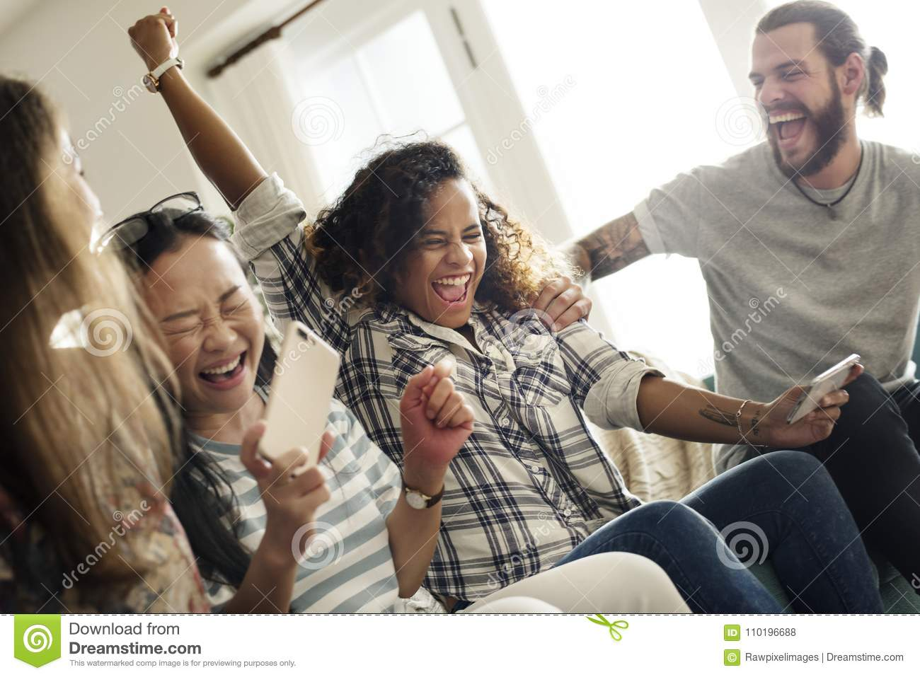 Group of diverse friends playing game on mobile phone