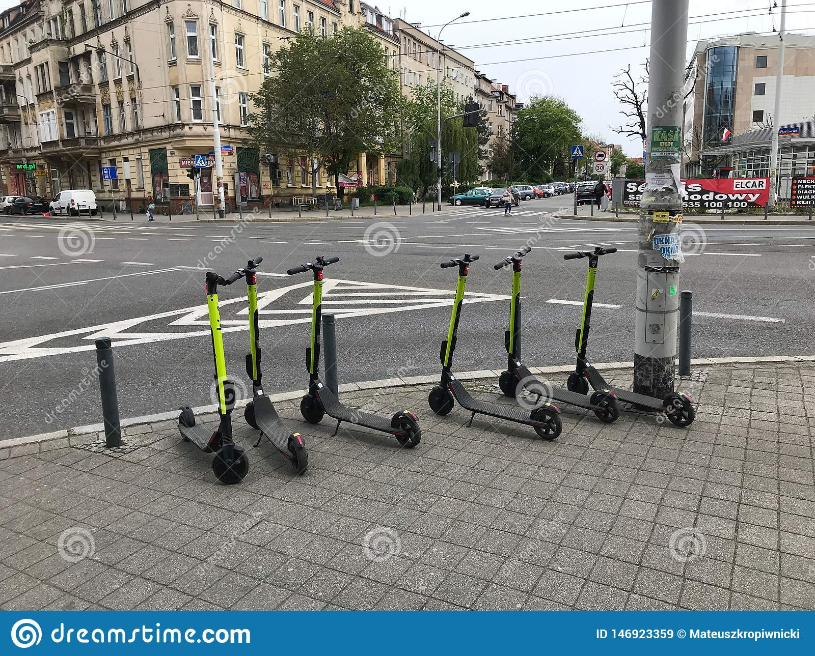 Electric scooters waiting to be used.