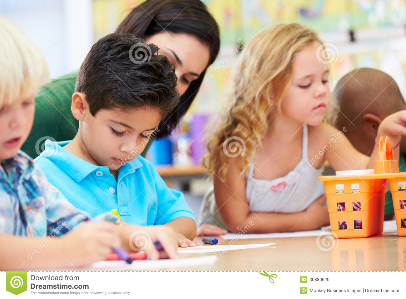 Group Of Elementary Age Children In Art Class With Teacher Stock ...