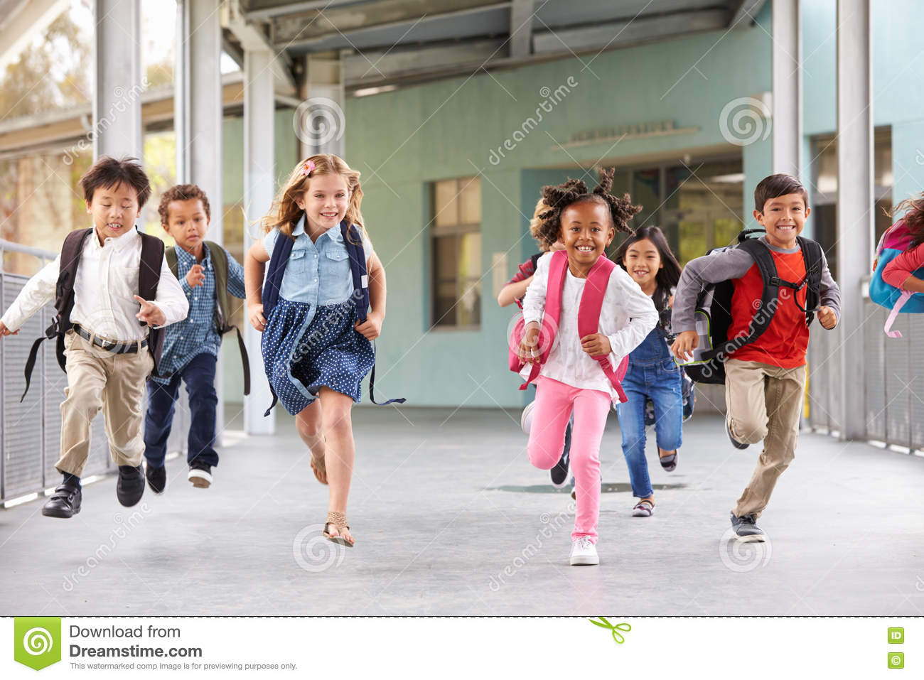 3ae7b46c874 Group Of Elementary School Kids Running In A School Corridor Stock ...