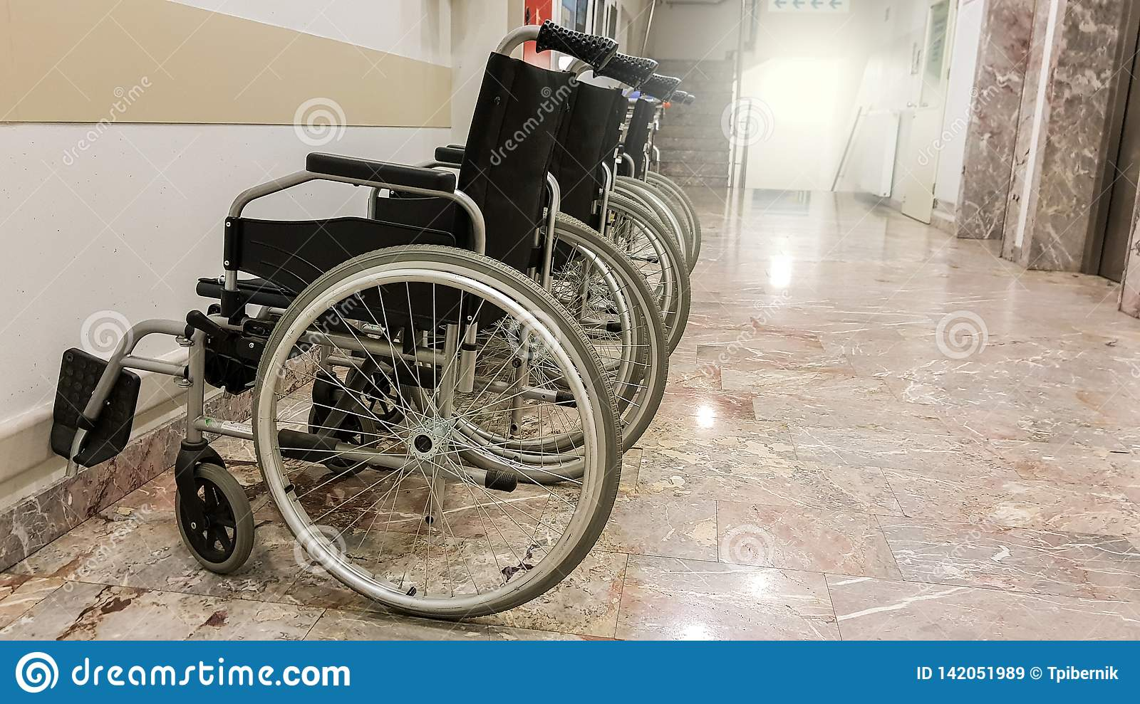Group of empty wheelchairs on a hallway ready for patients
