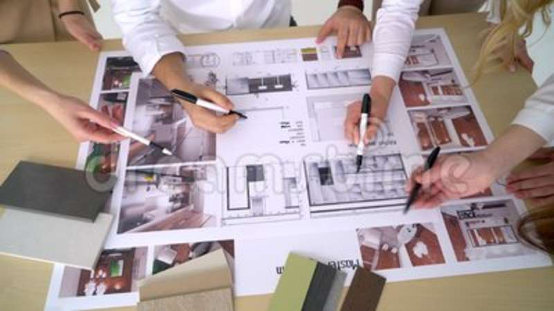 Group engineers and architects discuss the blueprint stock footage group engineers and architects discuss the blueprint stock footage video of busy architects 114706920 malvernweather Gallery