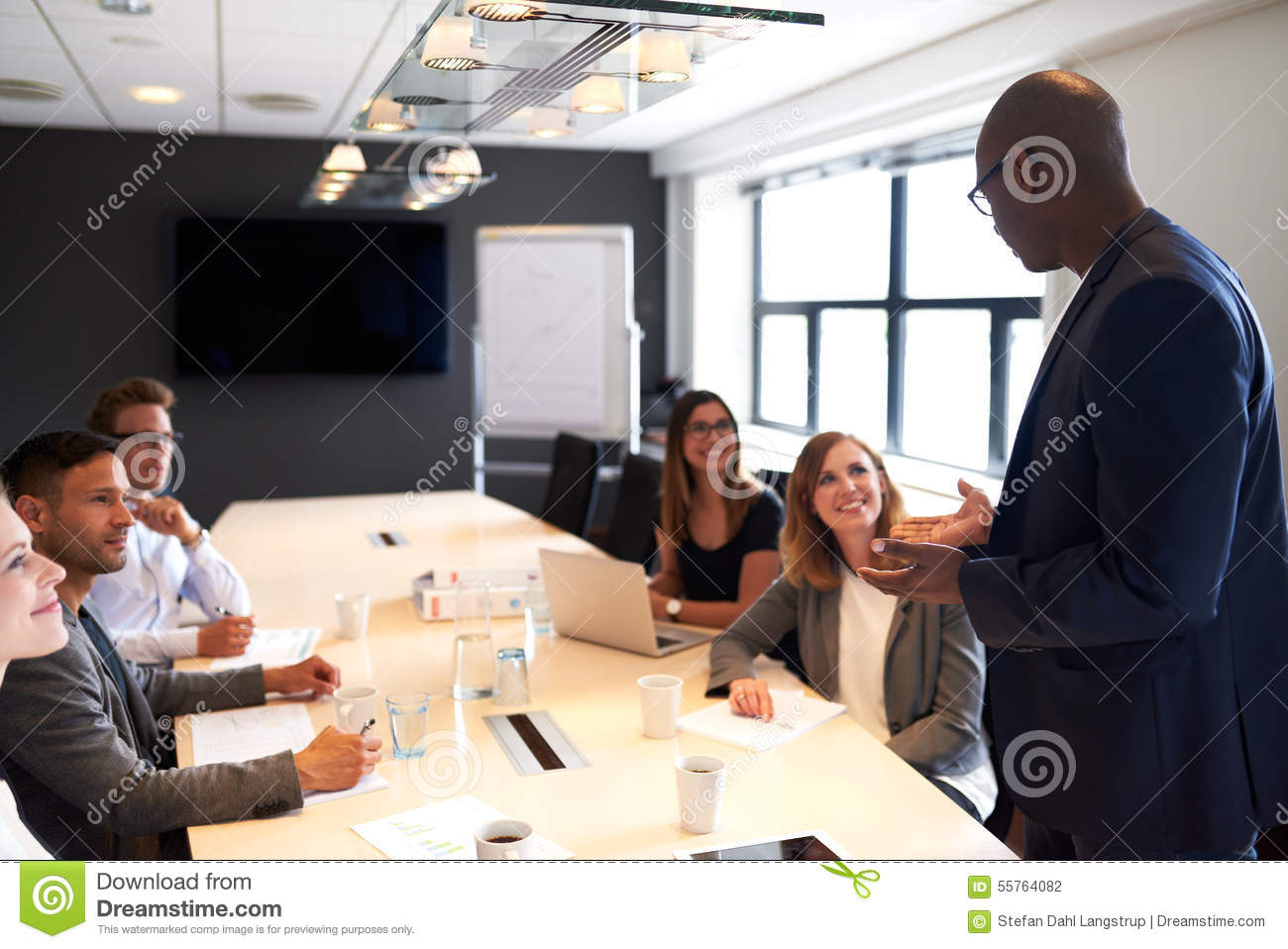Group of executives sitting in conference room