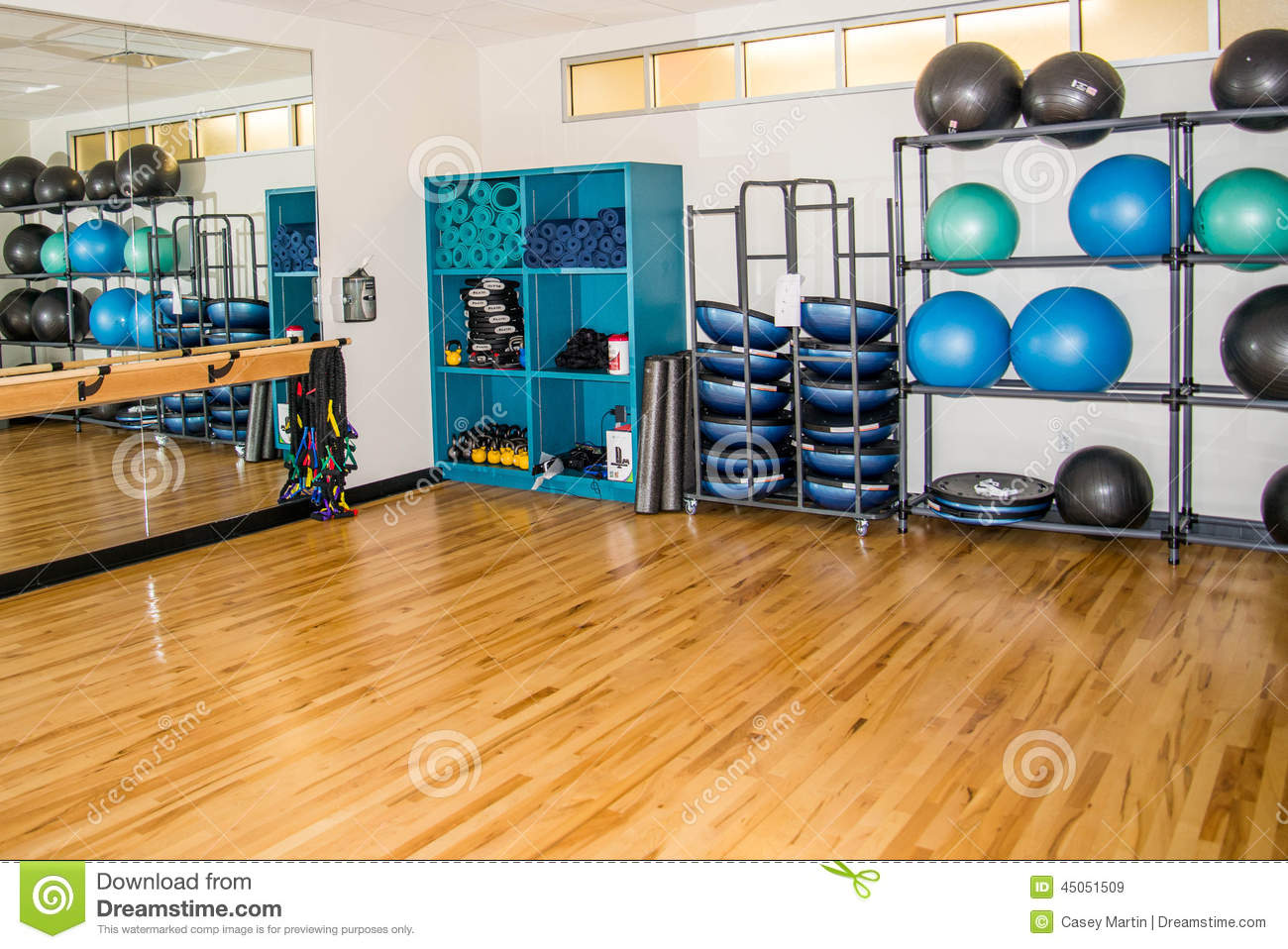Group exercise room with workout equipment stock photo