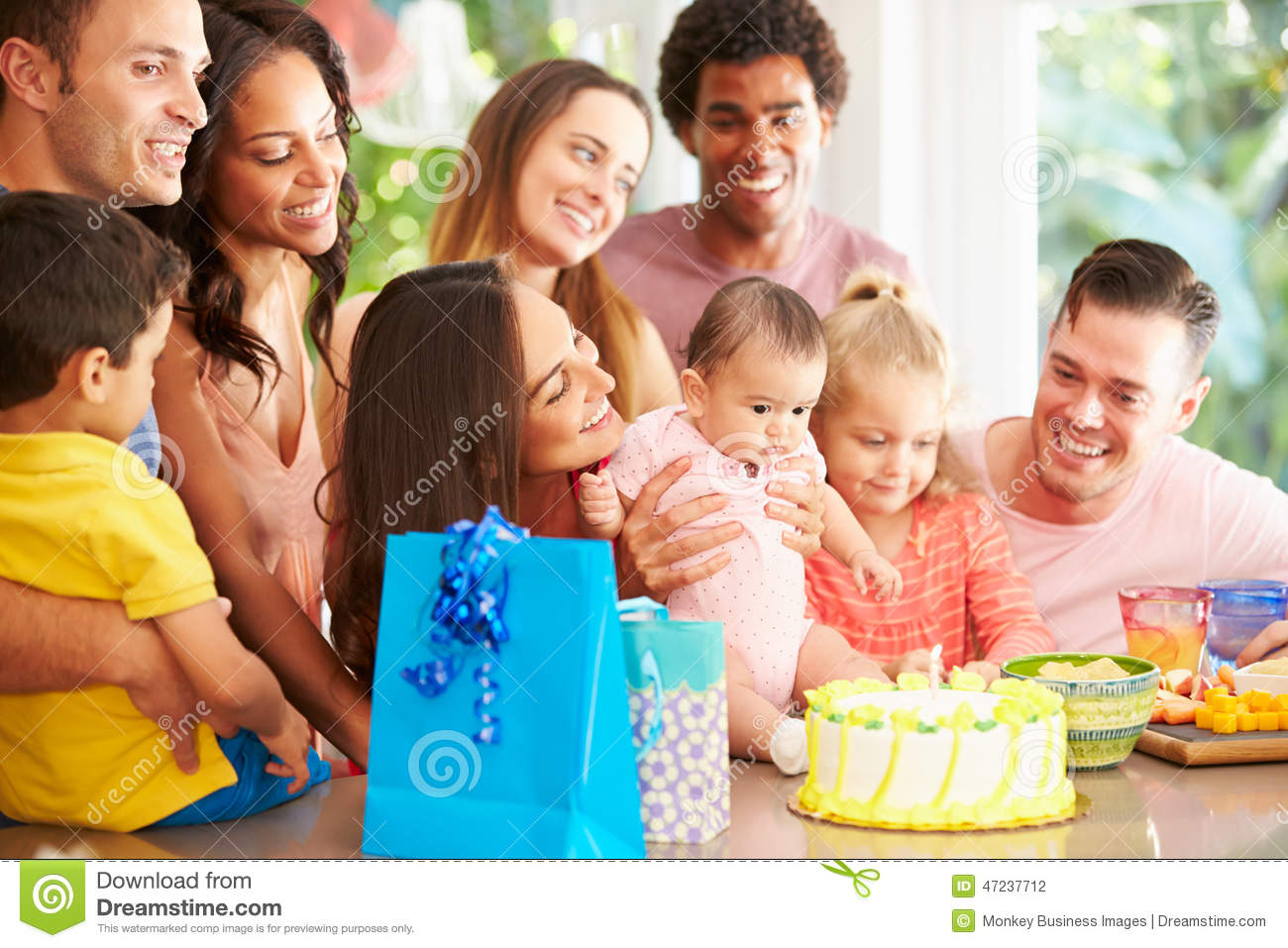 Group Of Families Celebrating Child s First Birthday At Home