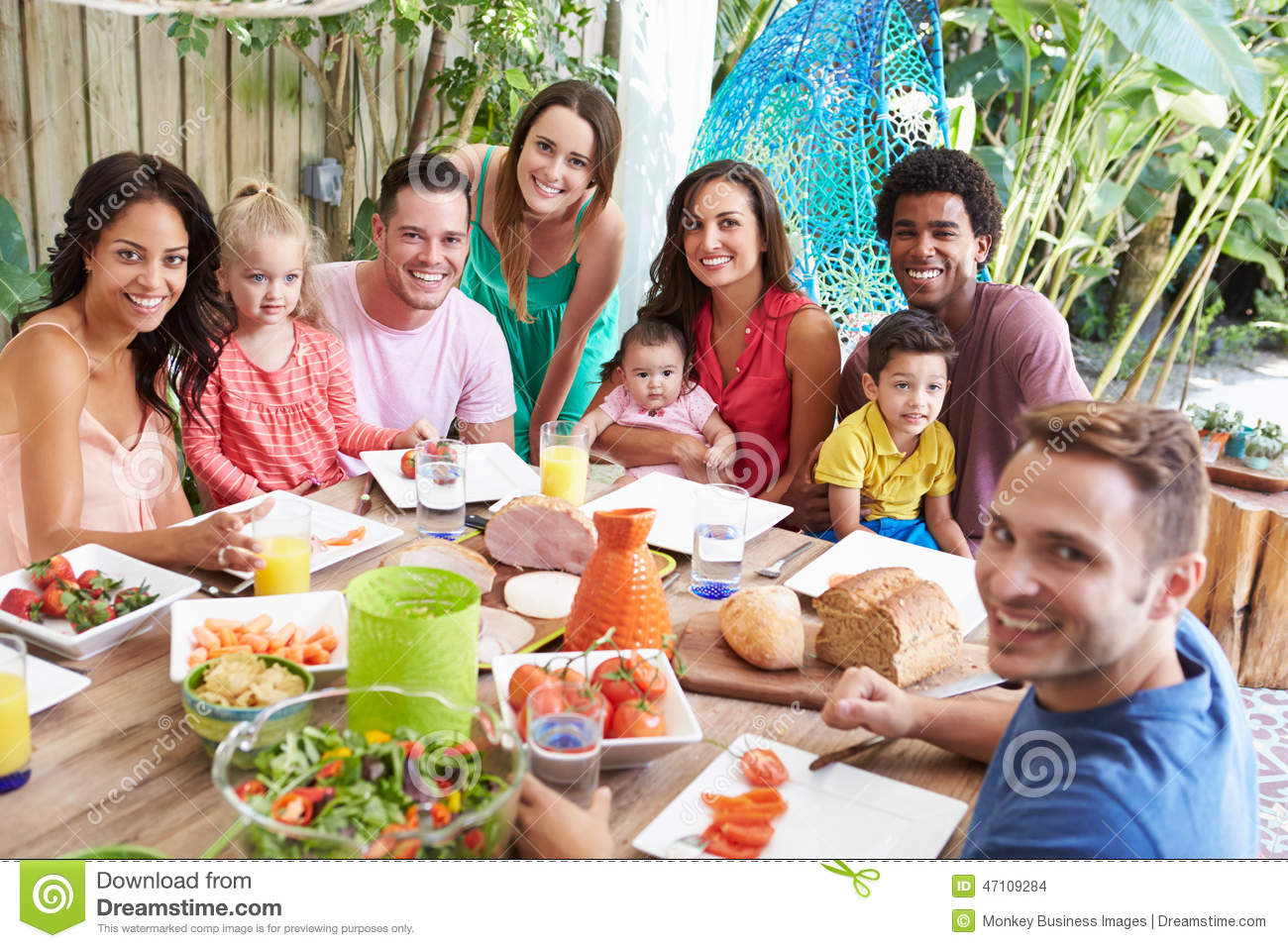 Group of families enjoying outdoor meal at home stock for Meal outdoors