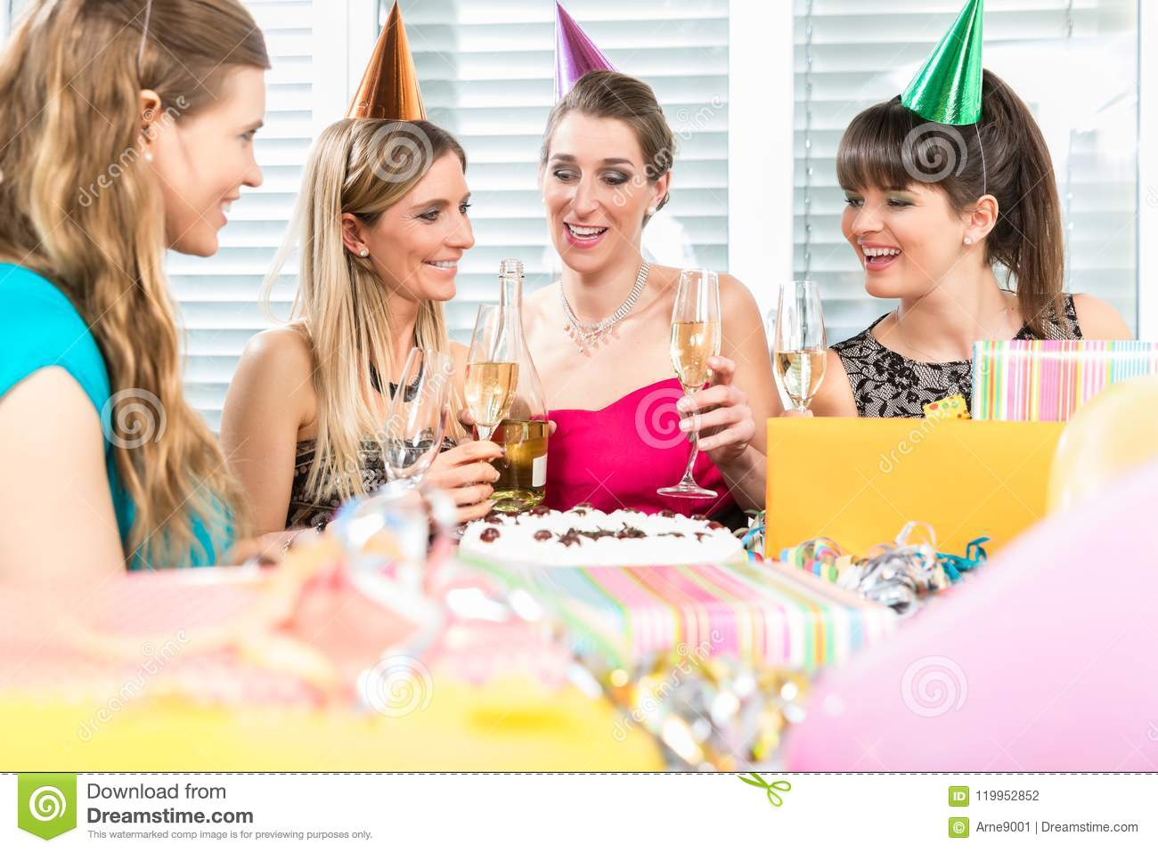 Group Of Female Best Friends Drinking Champagne In Front The Birthday Cake While Celebrating Together With Joy And Positive Thinking At Home