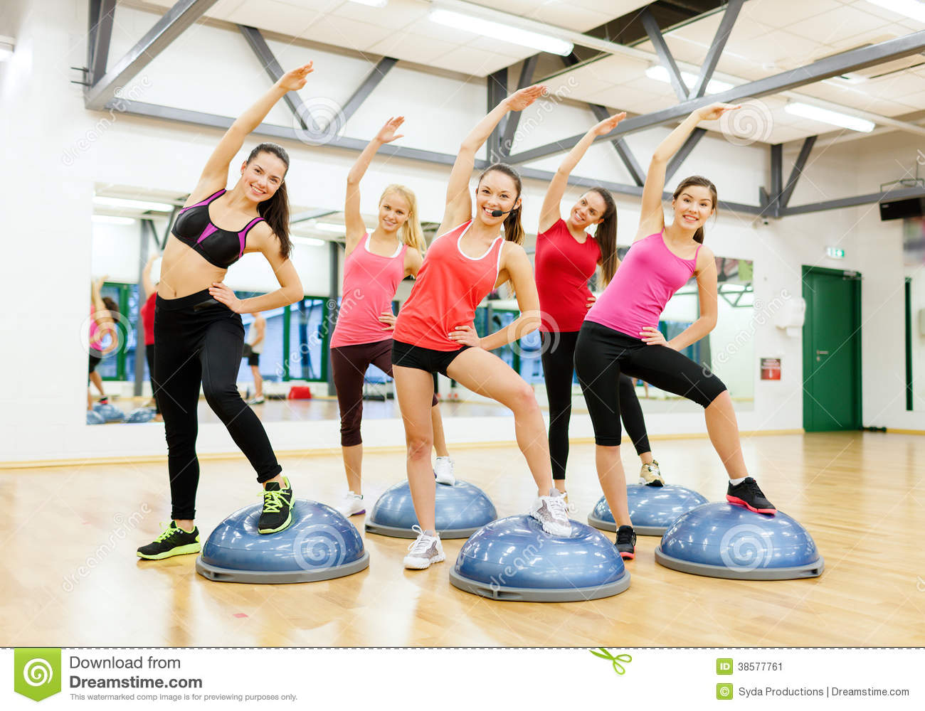 group of female doing aerobics with half ball stock image image of smiling happiness 38577761. Black Bedroom Furniture Sets. Home Design Ideas
