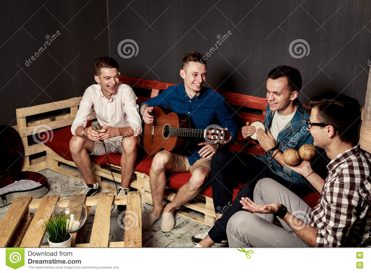 Group of four friends hanging out in studio stock photo for Hanging groups of pictures