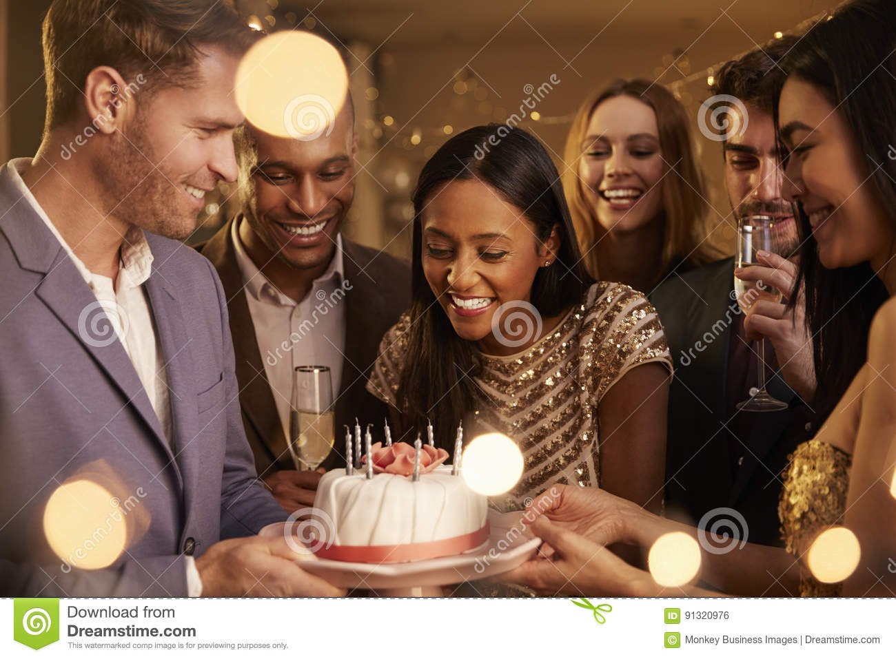 Group Of Friends Celebrating Birthday With Party At Home