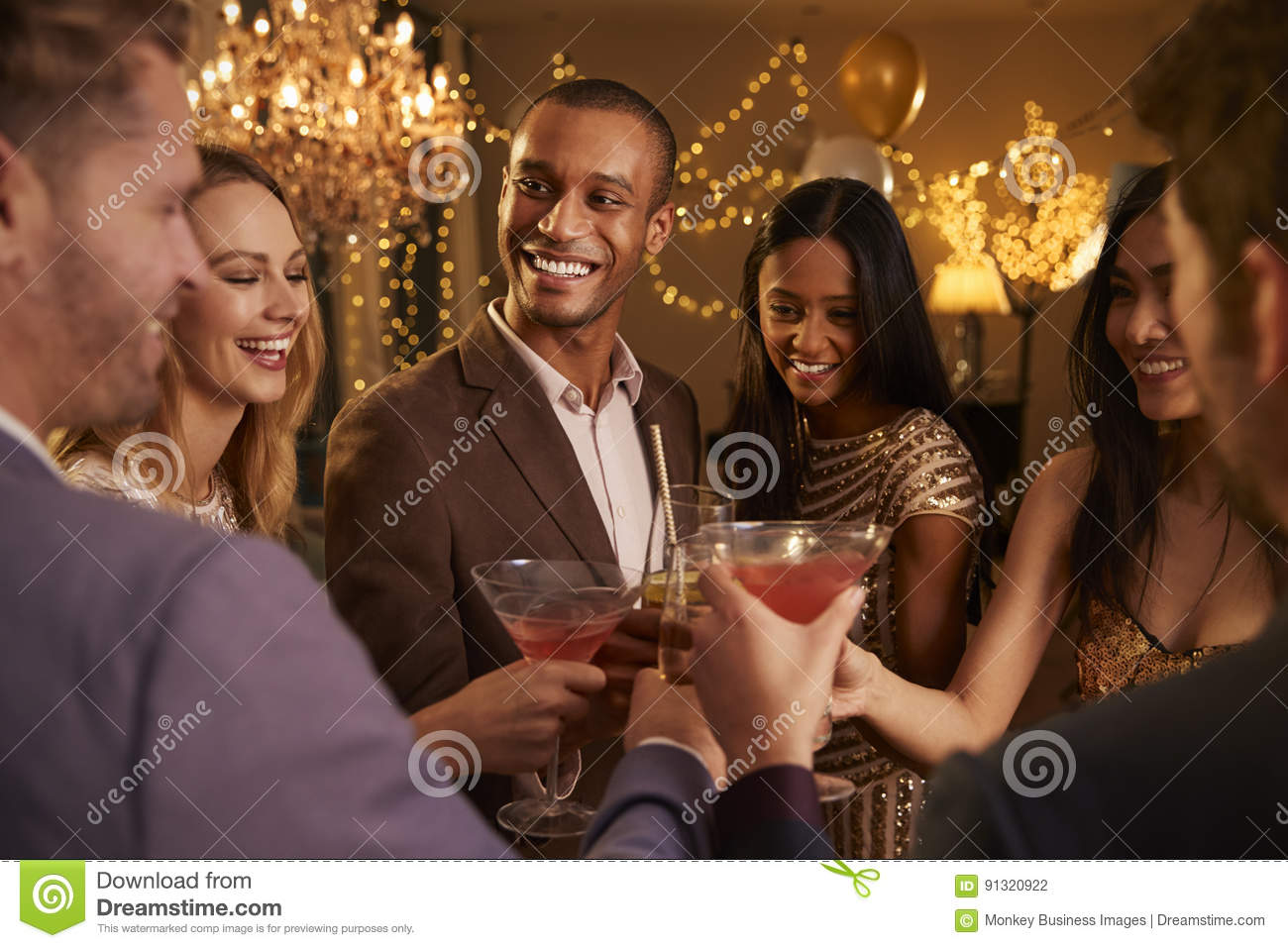 Group Of Friends With Drinks Enjoying Cocktail Party
