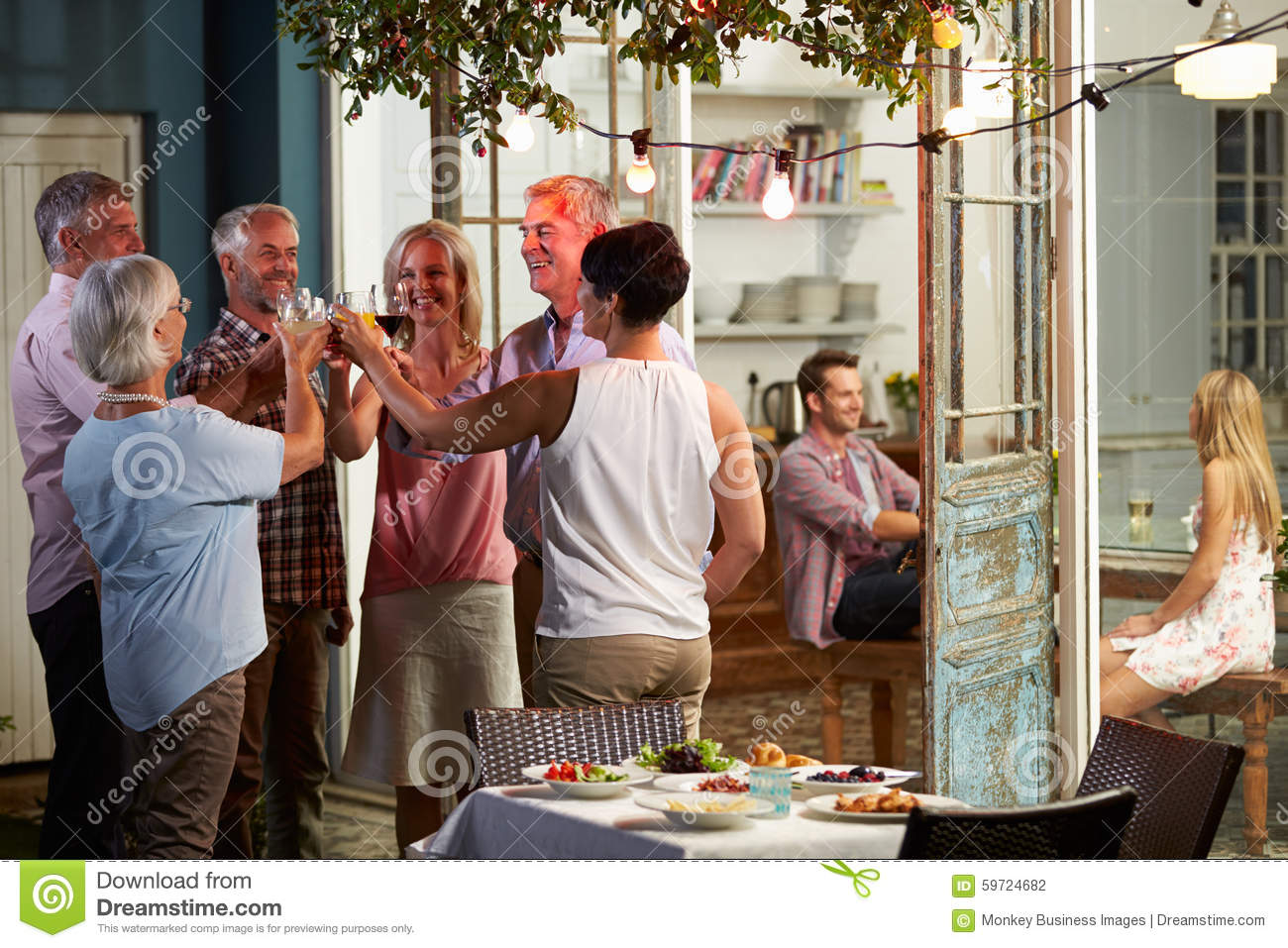 Group Of Friends Enjoying Outdoor Evening Drinks Party