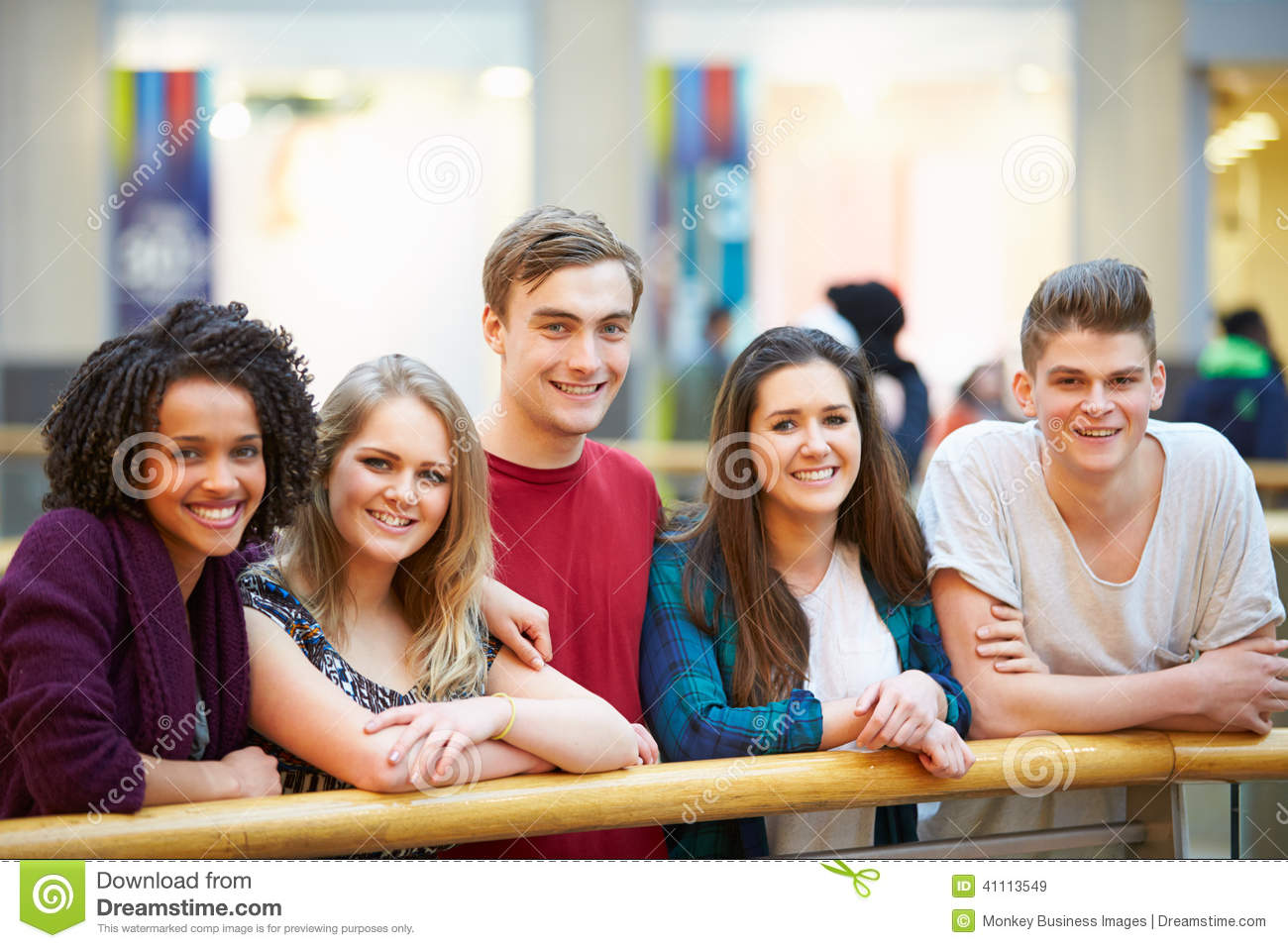 Group of friends hanging out in shopping mall stock photo for Hanging groups of pictures