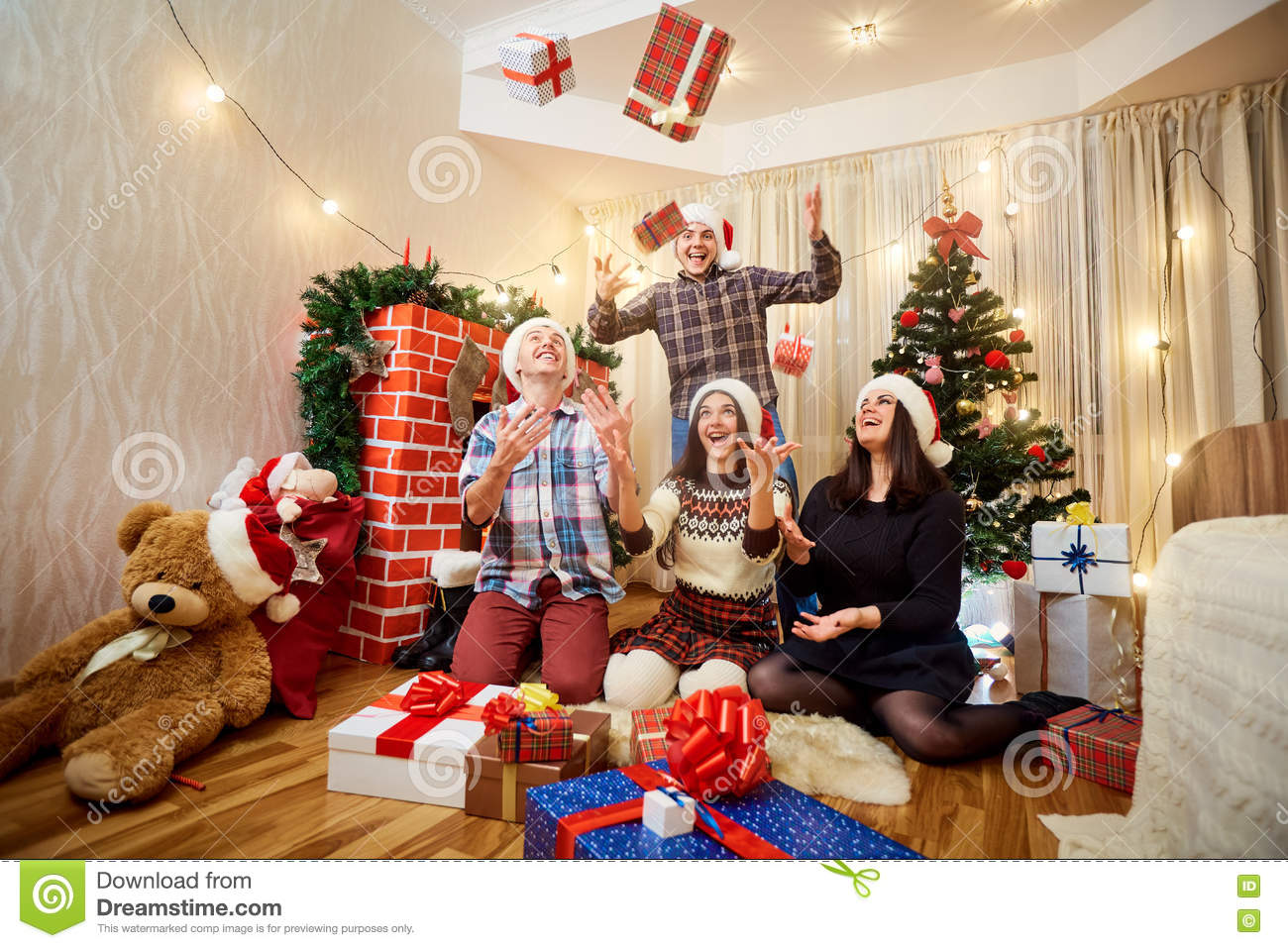 Group Of Friends In A Happy Christmas Gifts, Laughing ...