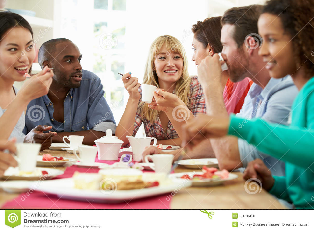 Group Of Friends Having Cheese And Coffee At Dinner Party ...