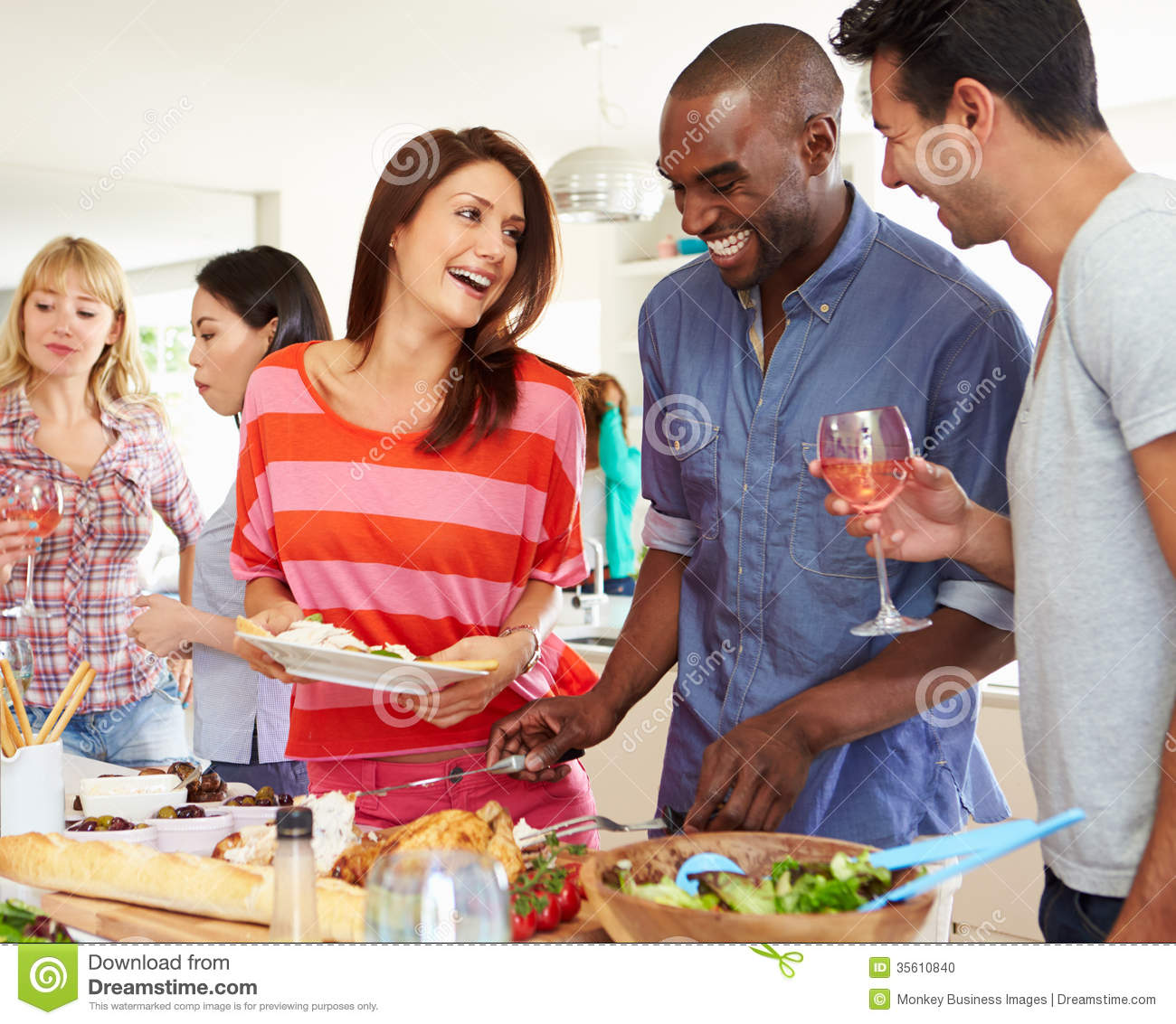 Group Of Friends Having Dinner Party At Home Stock Photo ...