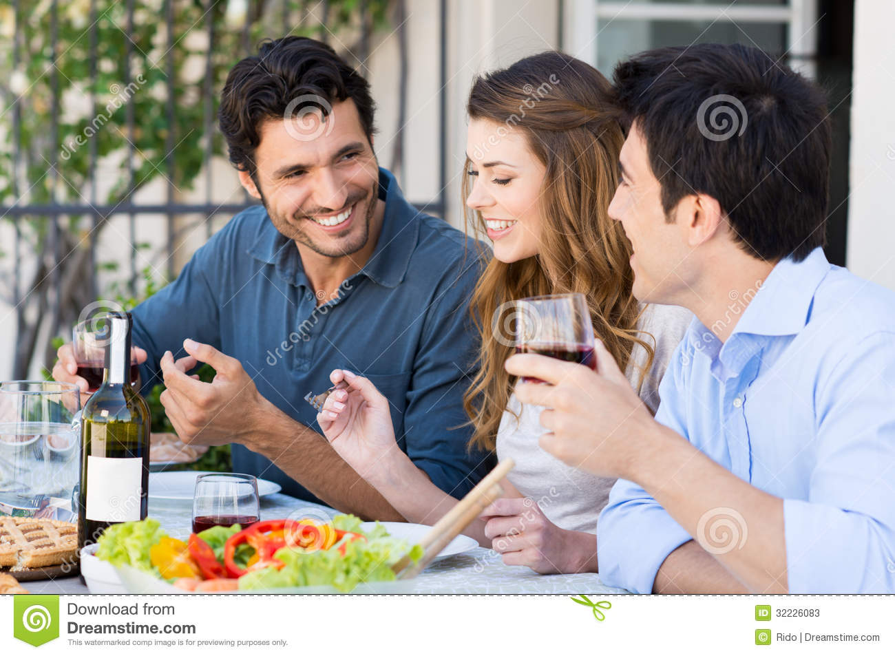 Group of friends having lunch stock photos image 32226083 for Group lunch