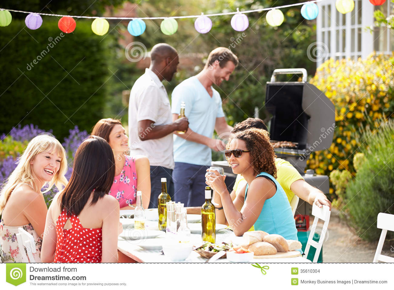 Gardening Group: Group Of Friends Having Outdoor Barbeque At Home Stock