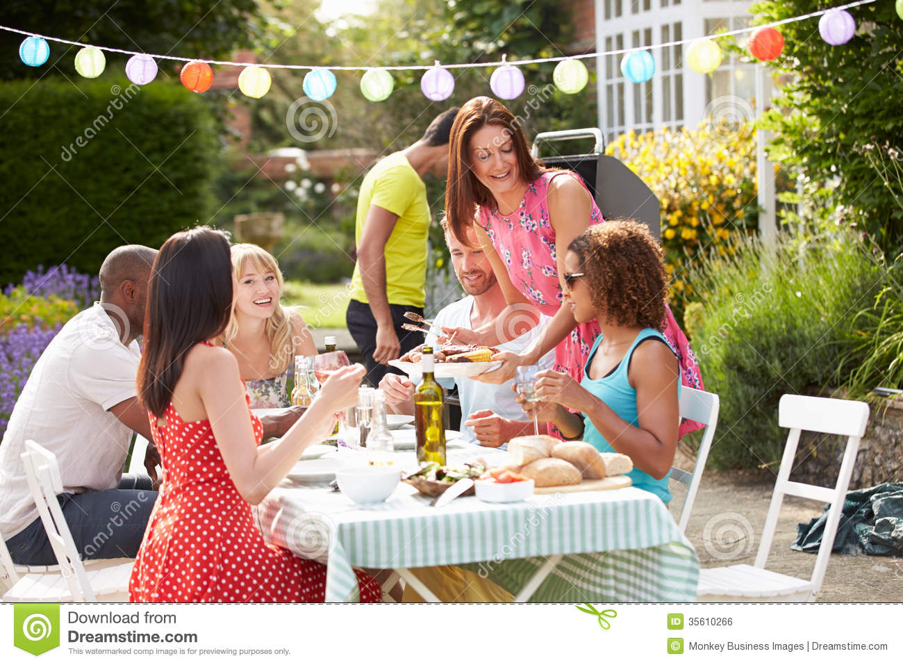 Group Of Friends Having Outdoor Barbeque At Home Royalty