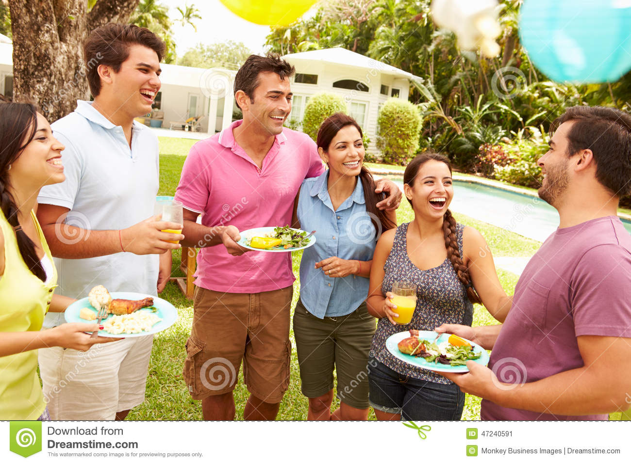 group of friends having party in backyard at home stock photo