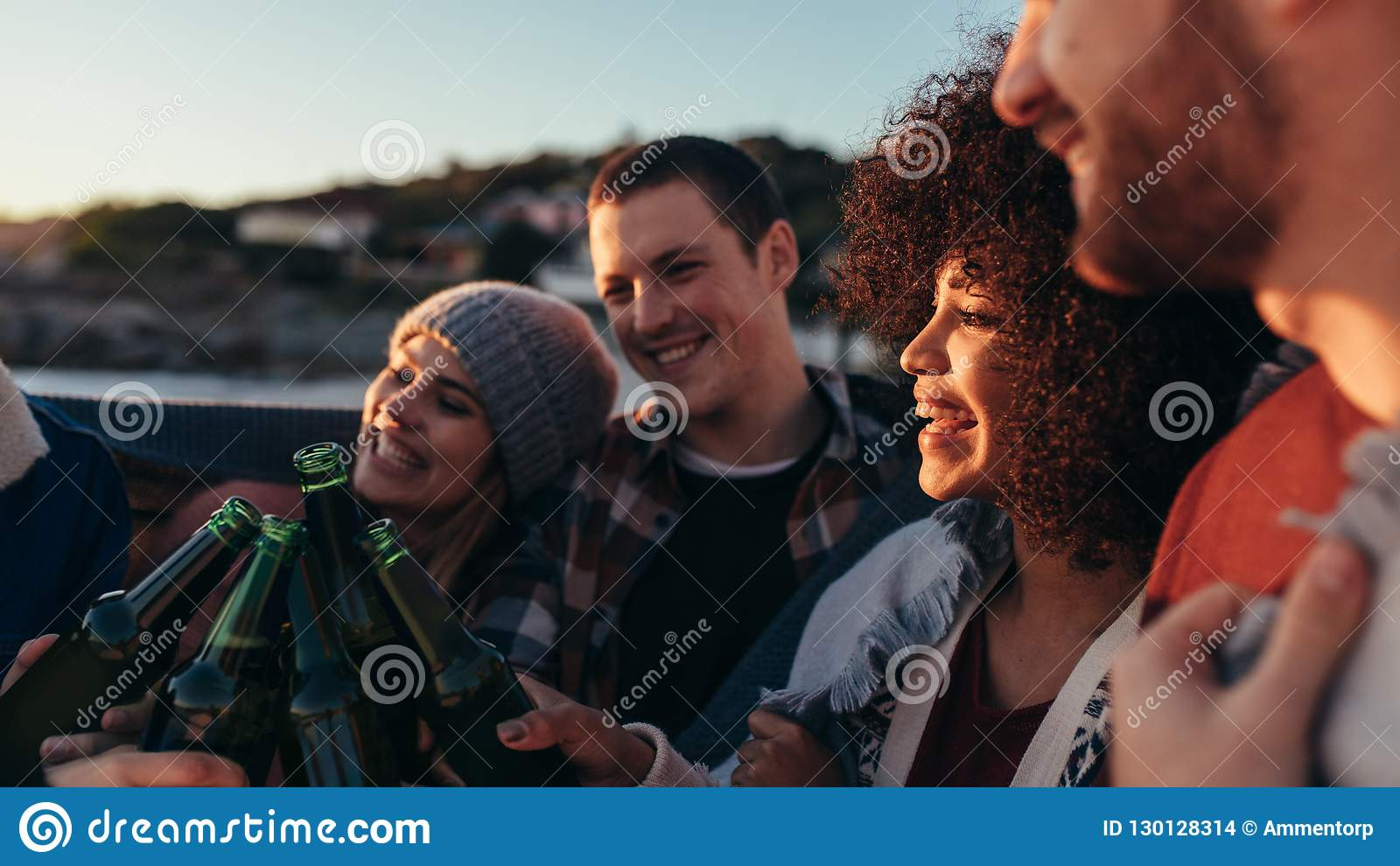 Group of friends having party at beach