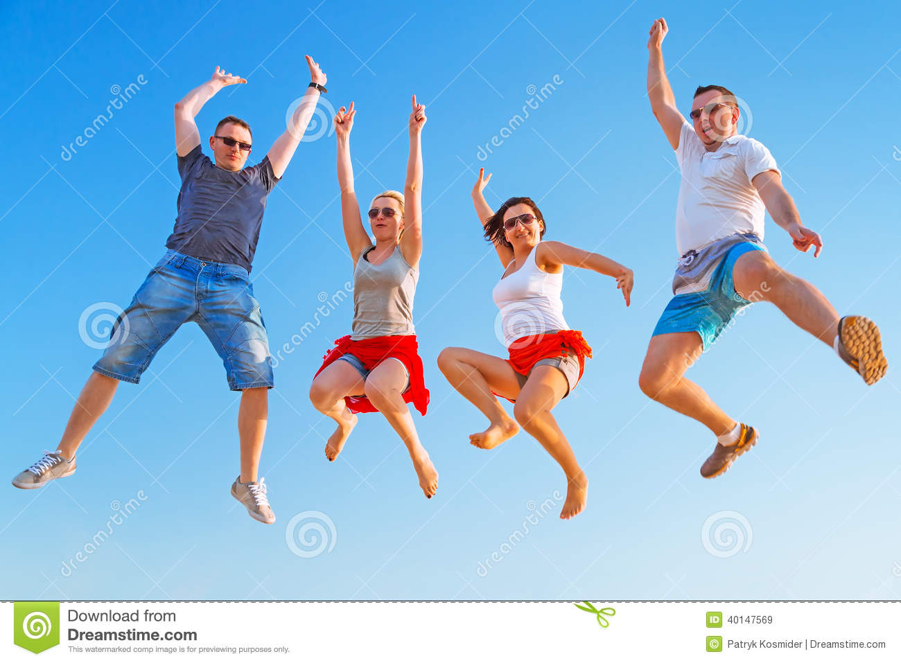 Group Of Friends Jumping With Happiness On Summer Holidays
