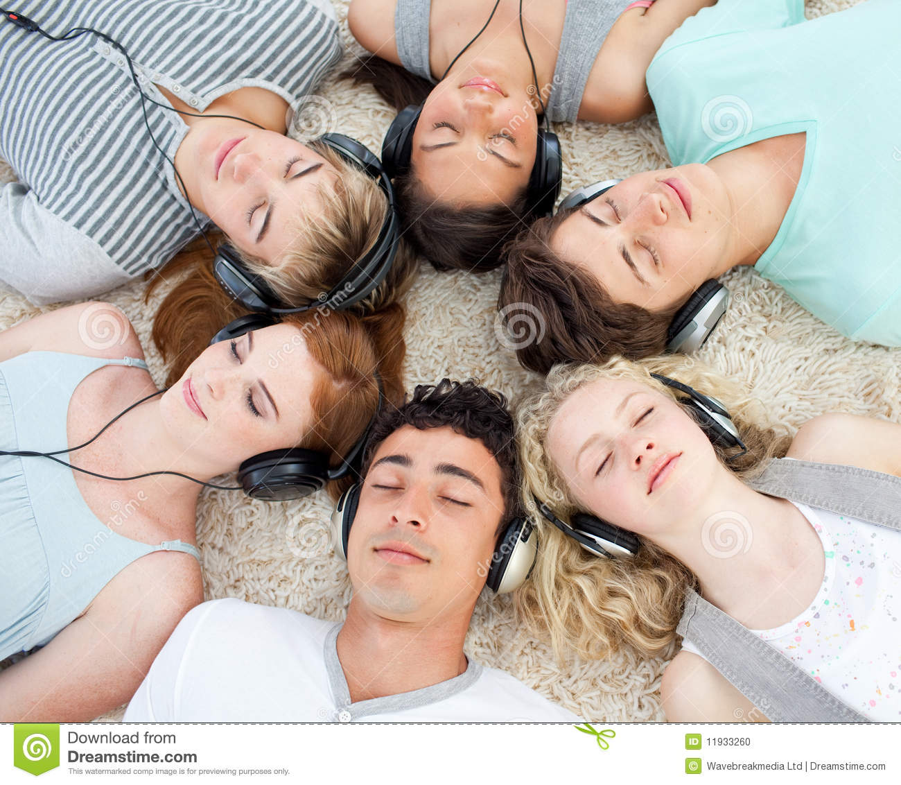 Group Of Friends Listening To Music On The Floor Stock ...