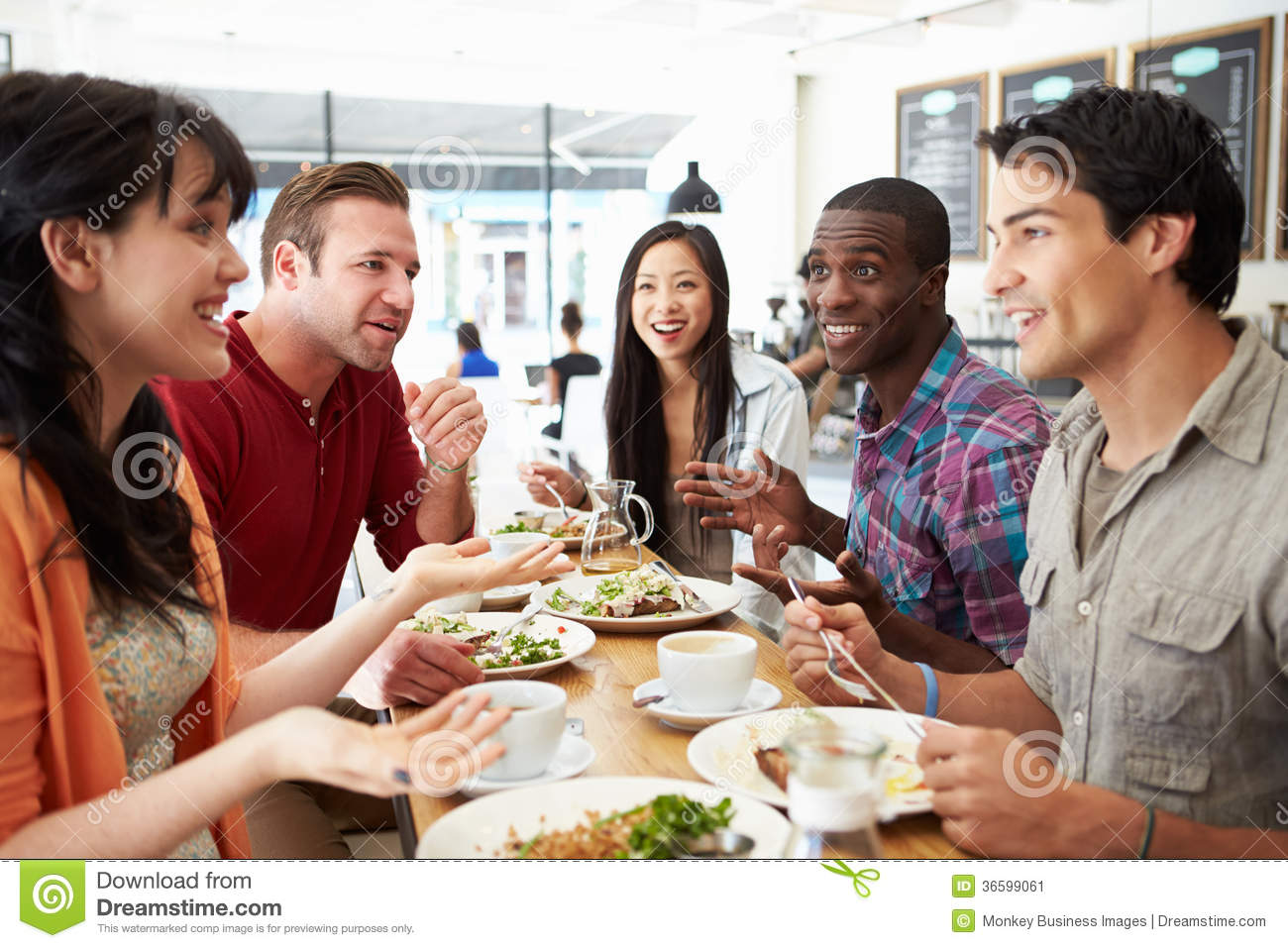 Group of friends meeting for lunch in coffee shop stock for Group lunch